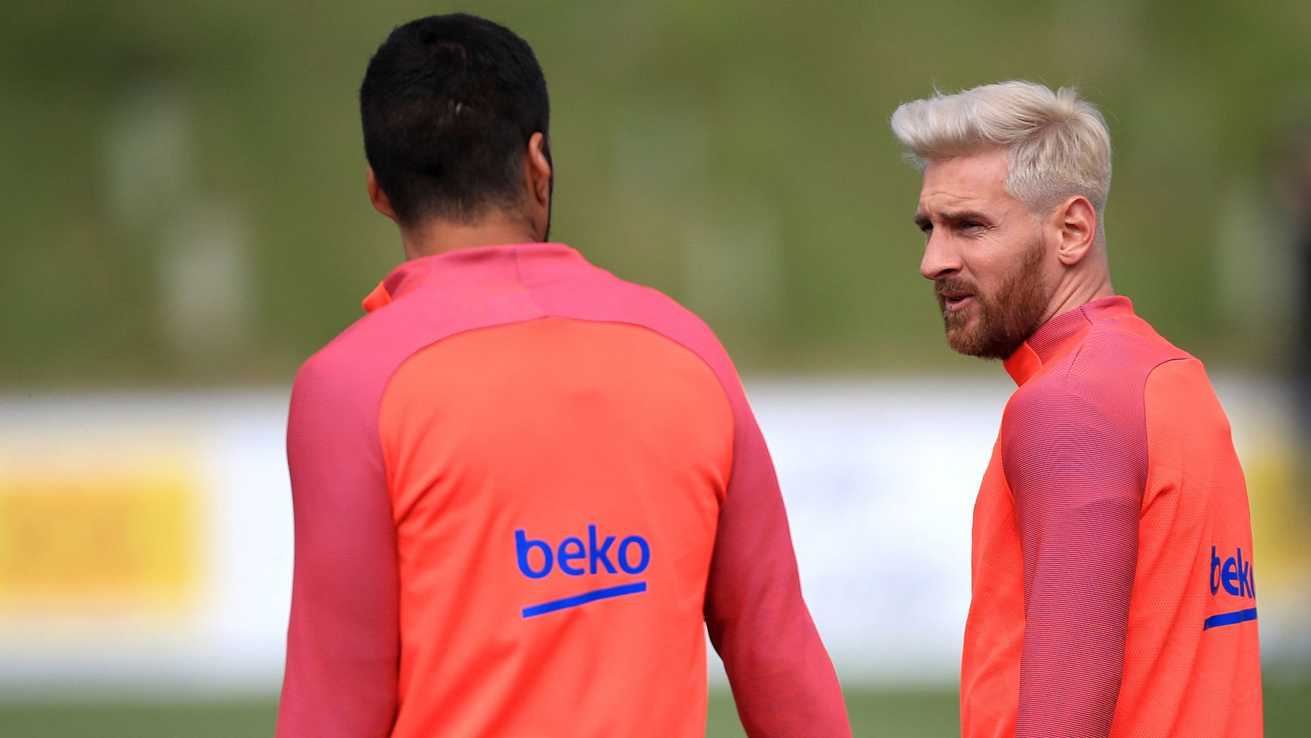 Barcelona's  star striker Lionel Messi, right, speaks with a teammate  during a training session at St George's Park, Burton, England Tuesday July 26, 2016. Barcelona are using the English FA's St. George's Park as a summer training camp. (Mike Egerton/PA via AP)