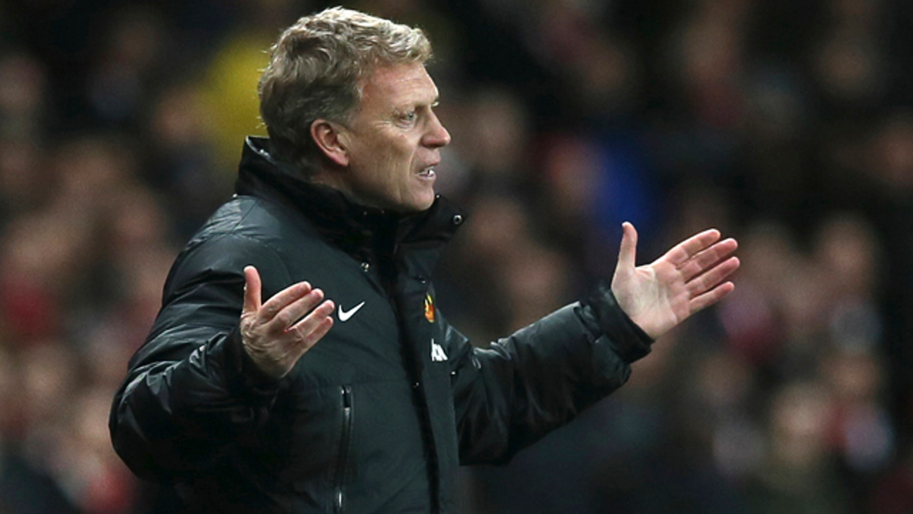 FILE - In this Wednesday, Feb. 12, 2014 file photo Manchester United's manager David Moyes gestures to his team during their English Premier League soccer match between Arsenal and Manchester United at the Emirates stadium in London. Manchester United says manager David Moyes has left the Premier League club after less than a year in charge, amid heavy speculation he was about to be fired. (AP Photo/Alastair Grant, File)