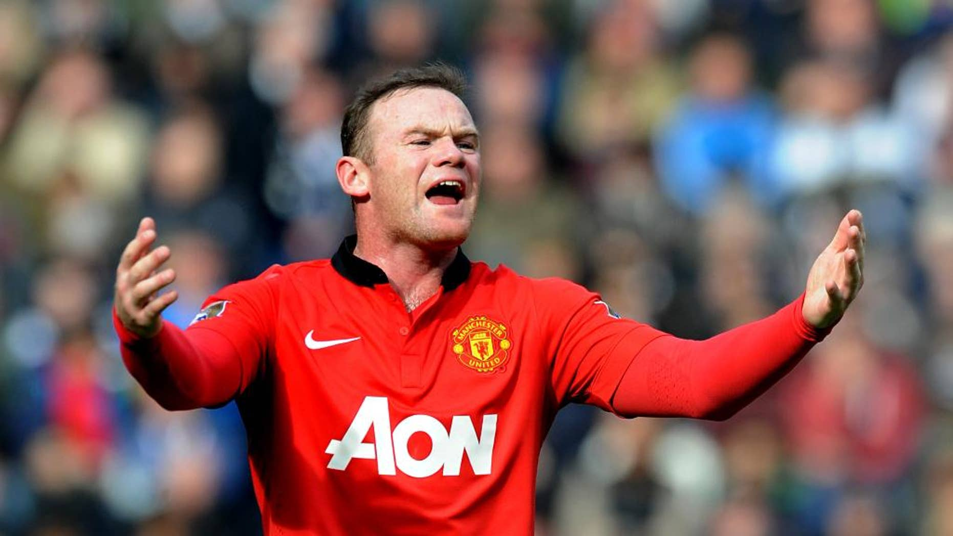 FILE - This is a Saturday, March 8, 2014 file photo of  Manchester United's Wayne Rooney as he  shouts instructions to teammates during the English Premier League soccer match between West Bromwich Albion and Manchester United at The Hawthorns Stadium in West Bromwich, England. Manchester United on Monday July 14, 2014 secured the most lucrative kit deal in football, announcing that Adidas has agreed to pay $1.3 billion over 10 years to take over the sponsorship from Nike. The deal, worth 75 million pounds ($128 million) a year from 2015, was announced after Nike decided that trebling the cost of its existing 13-year equipment supply contract was not good value for the company.  (AP Photo/Rui Vieira, File)
