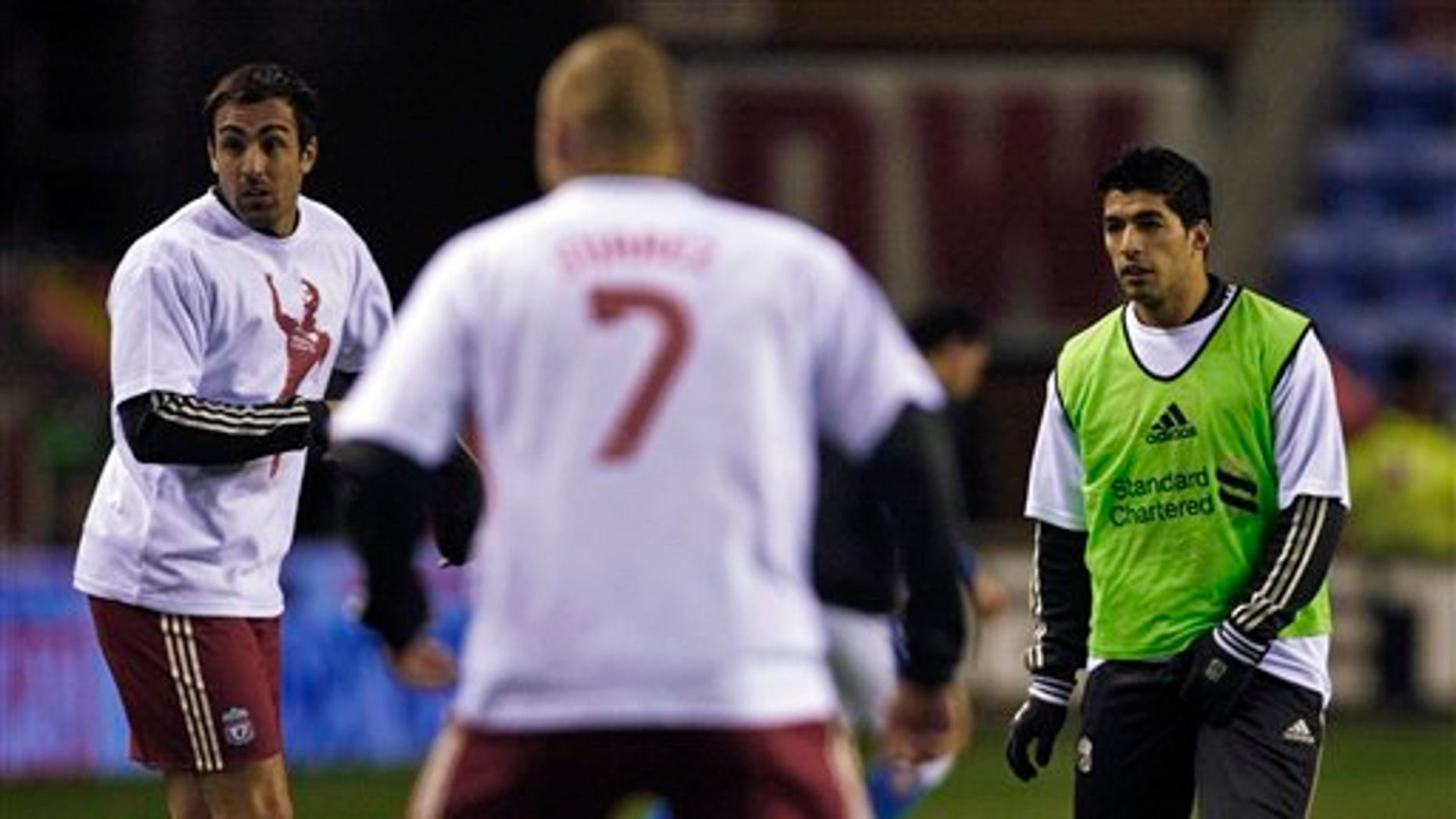 Dec. 21, 2011: Liverpool's Luis Suarez, right, warms up with teammates wearing Luis Suarez shirts before their English Premier League soccer match against Wigan at DW Stadium, Wigan, England.