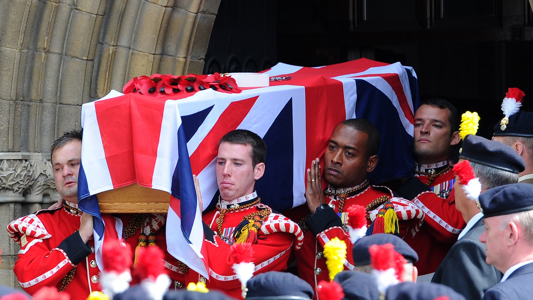 July 12, 2013 - The coffin of murdered Fusilier Lee Rigby is carried by soldiers after his funeral service at Bury Parish church in Greater Manchester, England. Relatives of the British soldier killed in broad daylight by alleged Islamic extremists say they are deeply grateful for the support they have received from the public. Rigby was hacked to death May 22 on a London street near his army barracks.