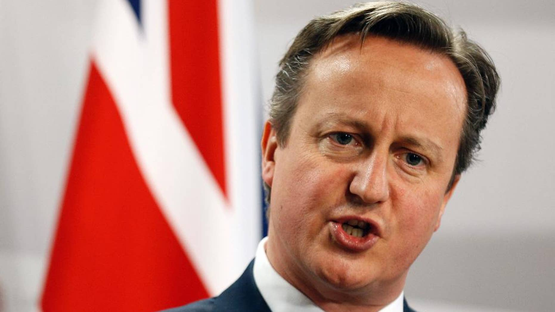 """FILE - This is a Friday, May 22, 2015  file photo of British Prime Minister David Cameron as he speaks during a media conference at the conclusion of the Eastern Partnership summit in Riga, Latvia. An influential group of lawmakers says launching British airstrikes against Islamic State group militants in Syria would be """"incoherent"""" and ineffective without a plan to end the country's civil war. The Foreign Affairs Select Committee has dealt a blow to Prime Minister David Cameron's attempts to expand British military action against the militants from Iraq into Syria. In a report published Tuesday, Nov. 3, 2015 the foreign affairs committee said Russia's intervention in the conflict in support of Bashar Assad's government """"has complicated even further any proposed action in Syria by the U.K."""" (AP Photo/Mindaugas Kulbis, File)"""