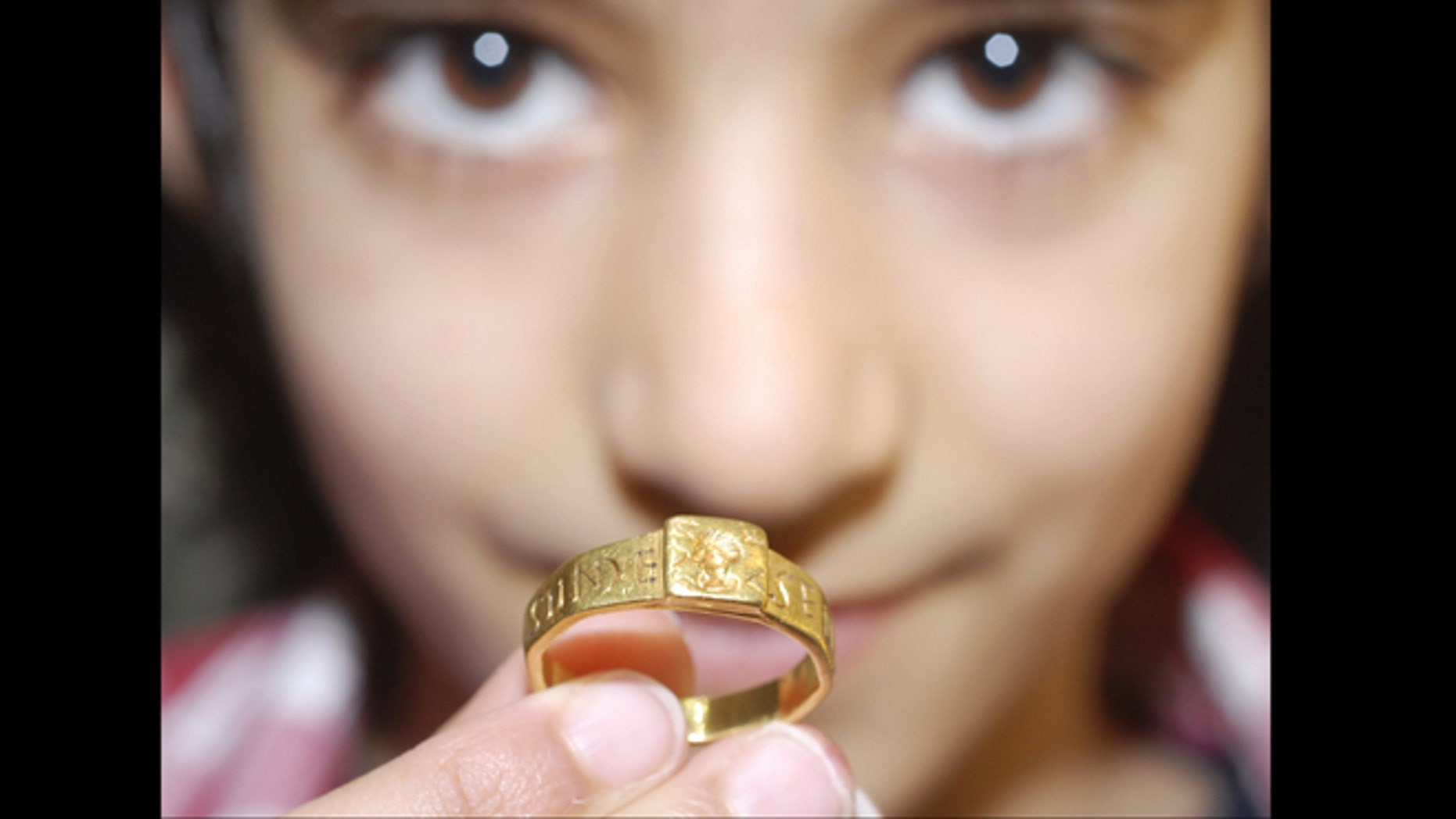 """April 2, 2013: A Roman gold ring that could have inspired J.R.R Tolkien to write """"The Hobbit"""" and """"The Lord of the Rings"""" is going on exhibition in England. Found in a field in southern England in 1785, the ring is linked to a Roman tablet inscribed with a curse on the thief who stole it."""