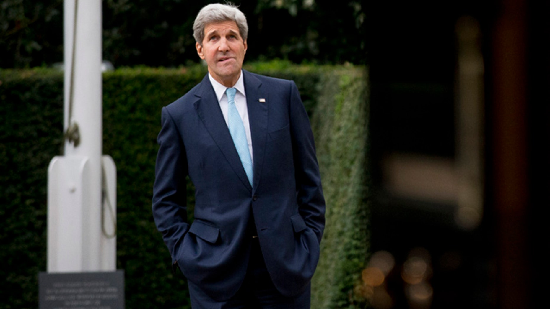 November 18, 2014: U.S. Secretary of State John Kerry waits for the arrival of Oman Foreign Minister Yusuf Bin Alawi bin Abdullah for their meeting at the official residence of the U.S. ambassador to Britain, Winfield House, in London.  (AP Photo/Matt Dunham)
