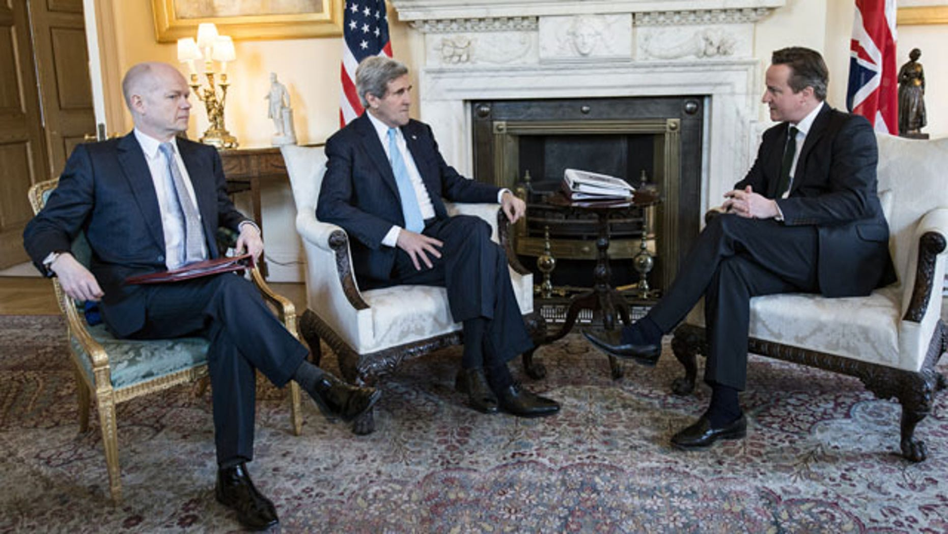 March 14, 2014: Britain's Prime Minister David Cameron, right, and Foreign Secretary William Hague, left, meet with US Secretary of State John Kerry in Downing Street, central London. (AP Photo/Brendan Smialowski, Pool)