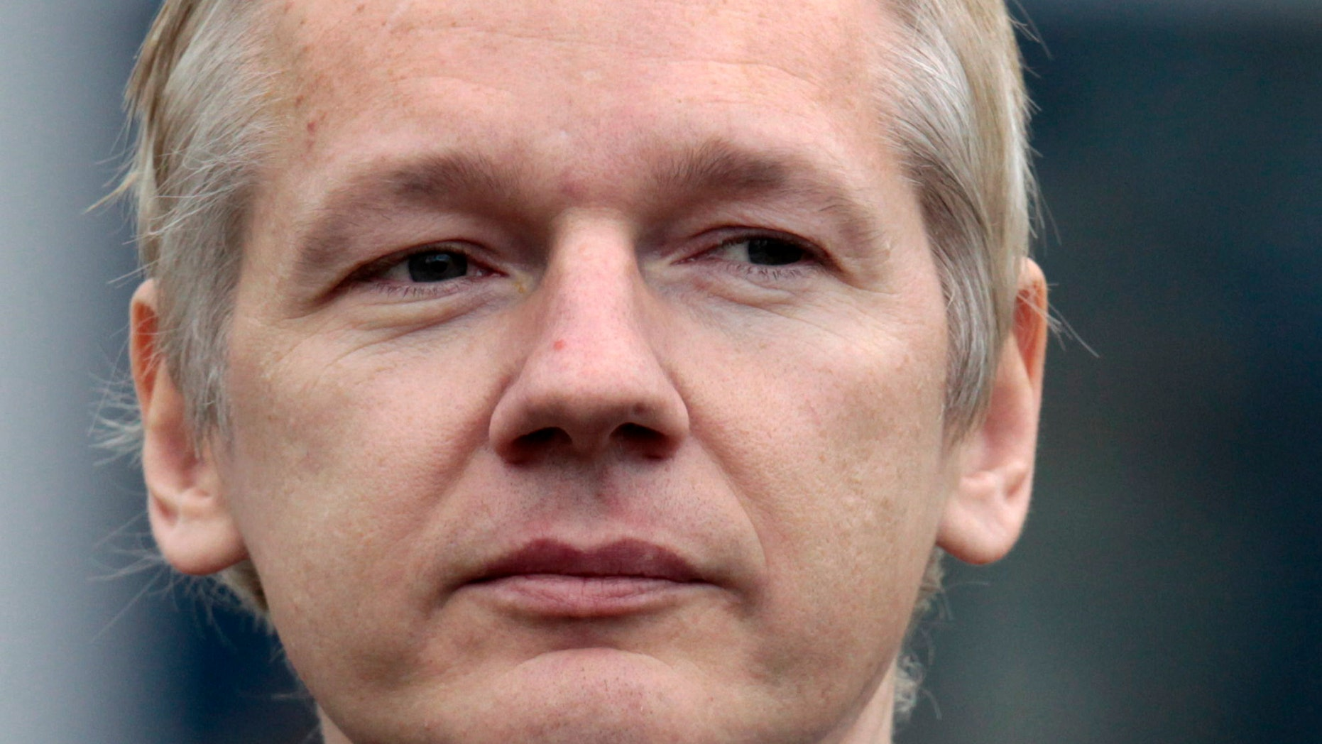 In this Jan. 11 file photo, the founder of WikiLeaks Julian Assange faces the media after making an appearance at Belmarsh Magistrates' Court in London. The New York Times is reporting that cables obtained by WikiLeaks reveal how the United States changed the way it dealt with Egypt after President Barack Obama came to power.
