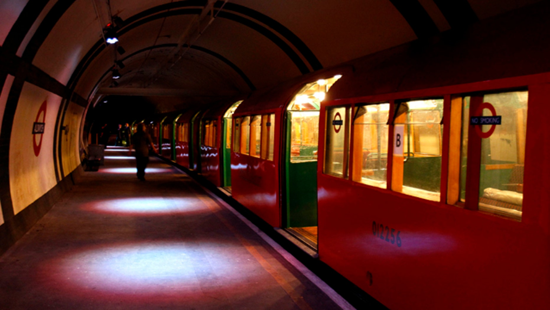 September 23: A 1938 tube train is seen at the platform in Aldwych Underground station in London.  As part of a series of commemorative events taking place in London to mark the 70th anniversary of the Blitz and the Battle of Britain, visitors are being allowed to descend into the disused Aldwych Underground station, public tickets have sold out already. (AP)