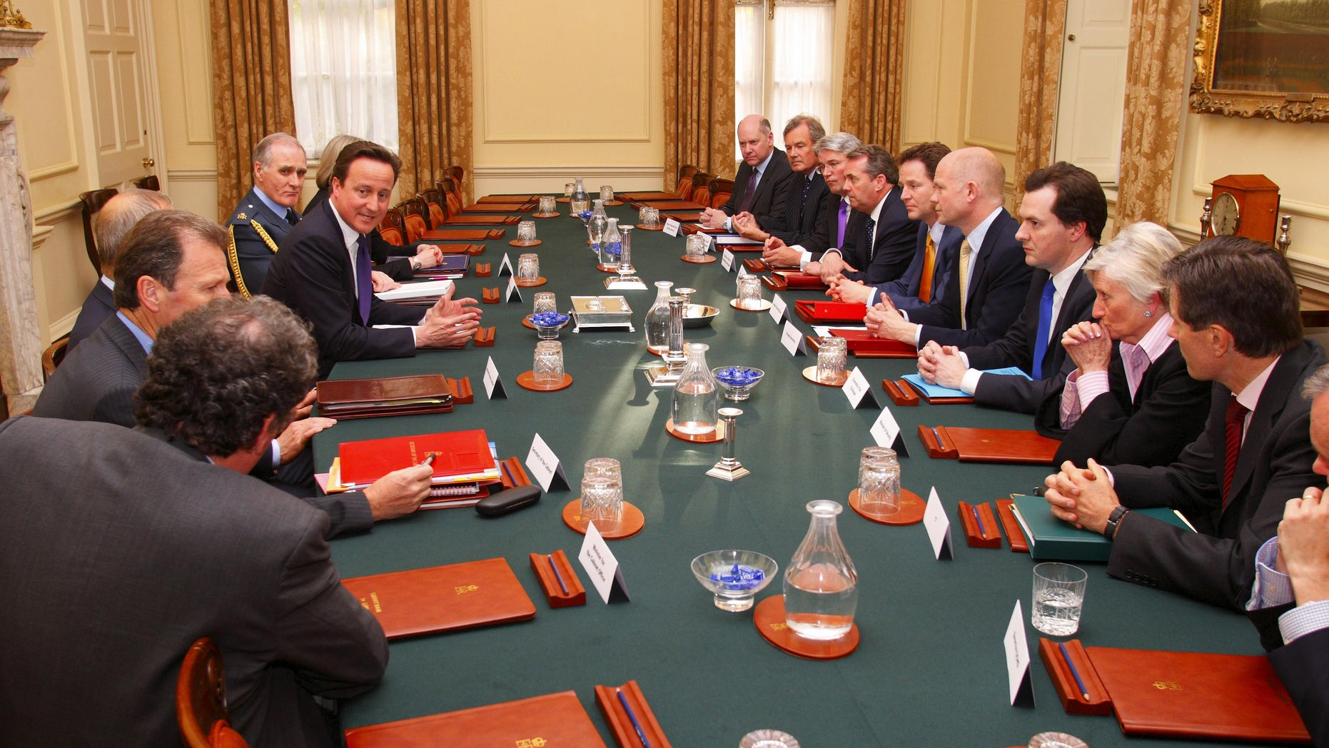 Britain's Prime Minister David Cameron, top, first left, chairs the first meeting of the National Security Council in the Cabinet Room at No.10 Downing Street. in central London, Wednesday, May 12, 2010. Others in attendance included Chief of the Defence Staff Sir Jock Stirrup, top left, Deputy Prime Minister Nick Clegg, fifth right, Foreign Secretary William Hague, sixth right, Chancellor George Osborne, seventh right and Defence Secretary Dr Liam Fox, fourth right. (AP Photo/Chris Ison, Pool)