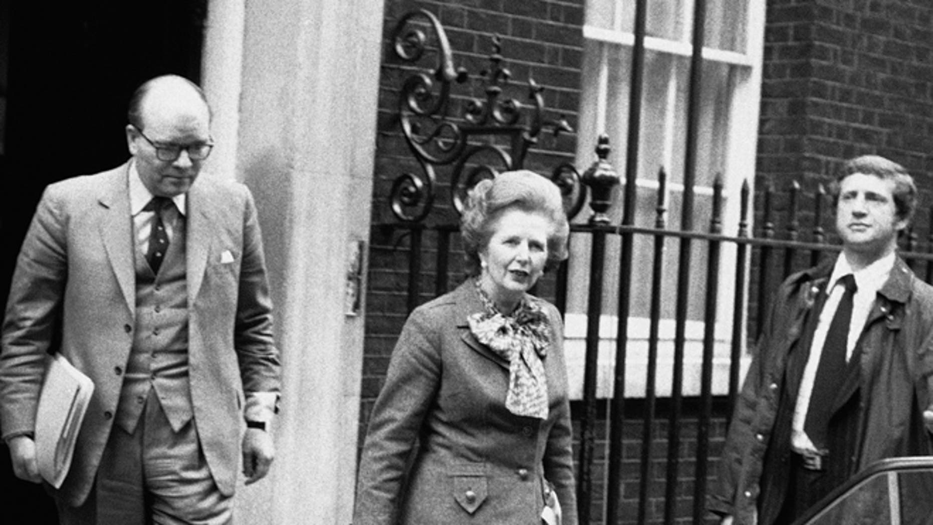 In this April 14, 1982 file photo, British Prime Minister Margaret Thatcher leaves her official 10 Downing Street residence in London, for an emergency session of Parliament on the Falklands crisis.