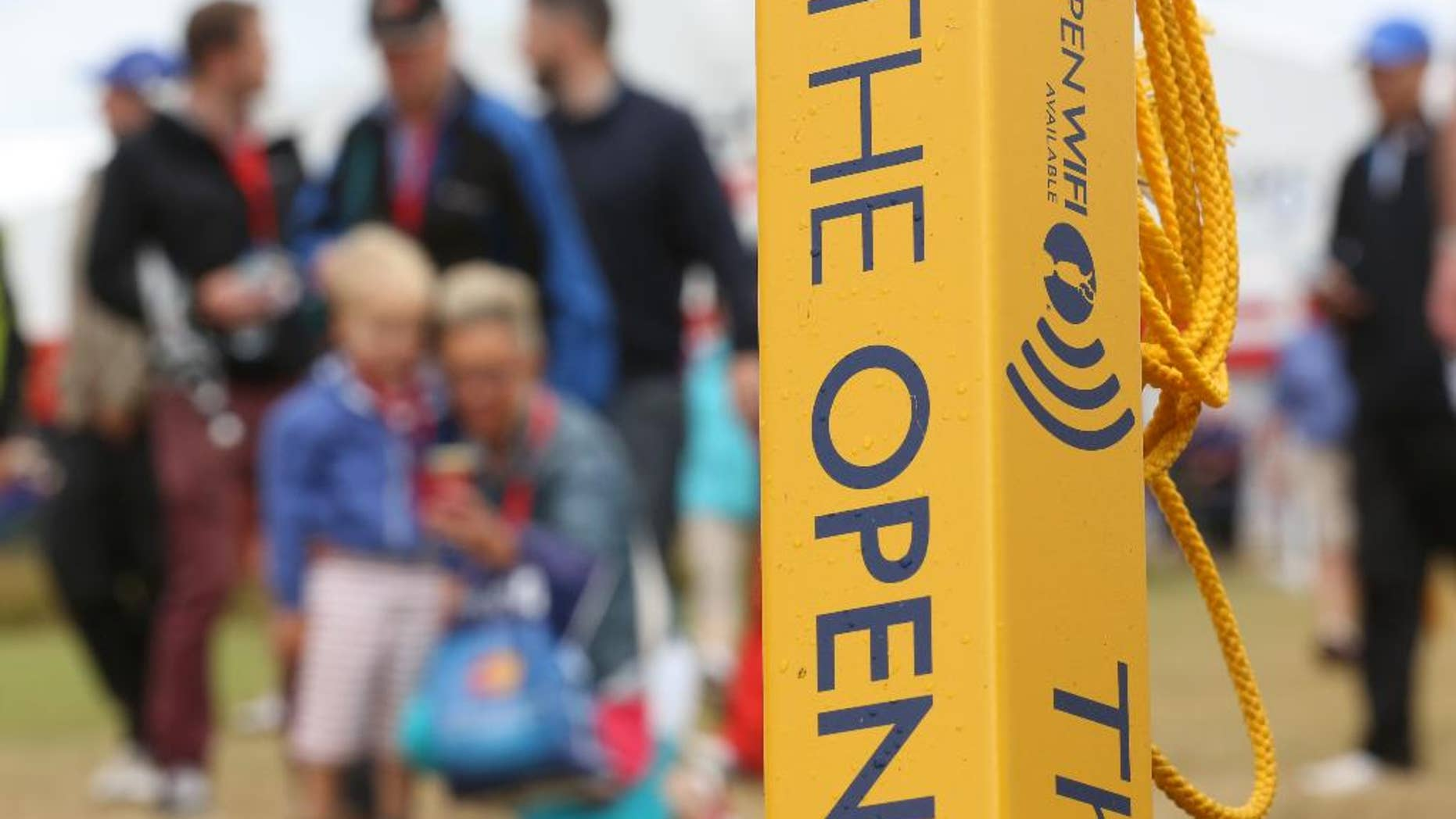 A sign advertising WiFi near the 3rd hole on the course at the Royal Liverpool golf club where the British Open Golf championship will start Thursday July 17, in Hoylake, England, Wednesday July 16, 2014. (AP Photo/Jon Super)