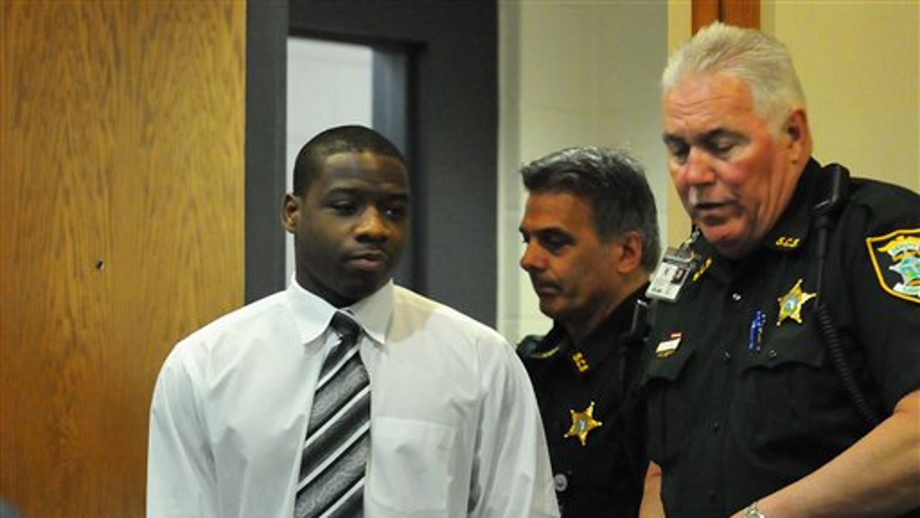 March 26: Shawn Tyson enters the court room on during the third day of his murder trial in Sarasota County Court in Sarasota, Fla.