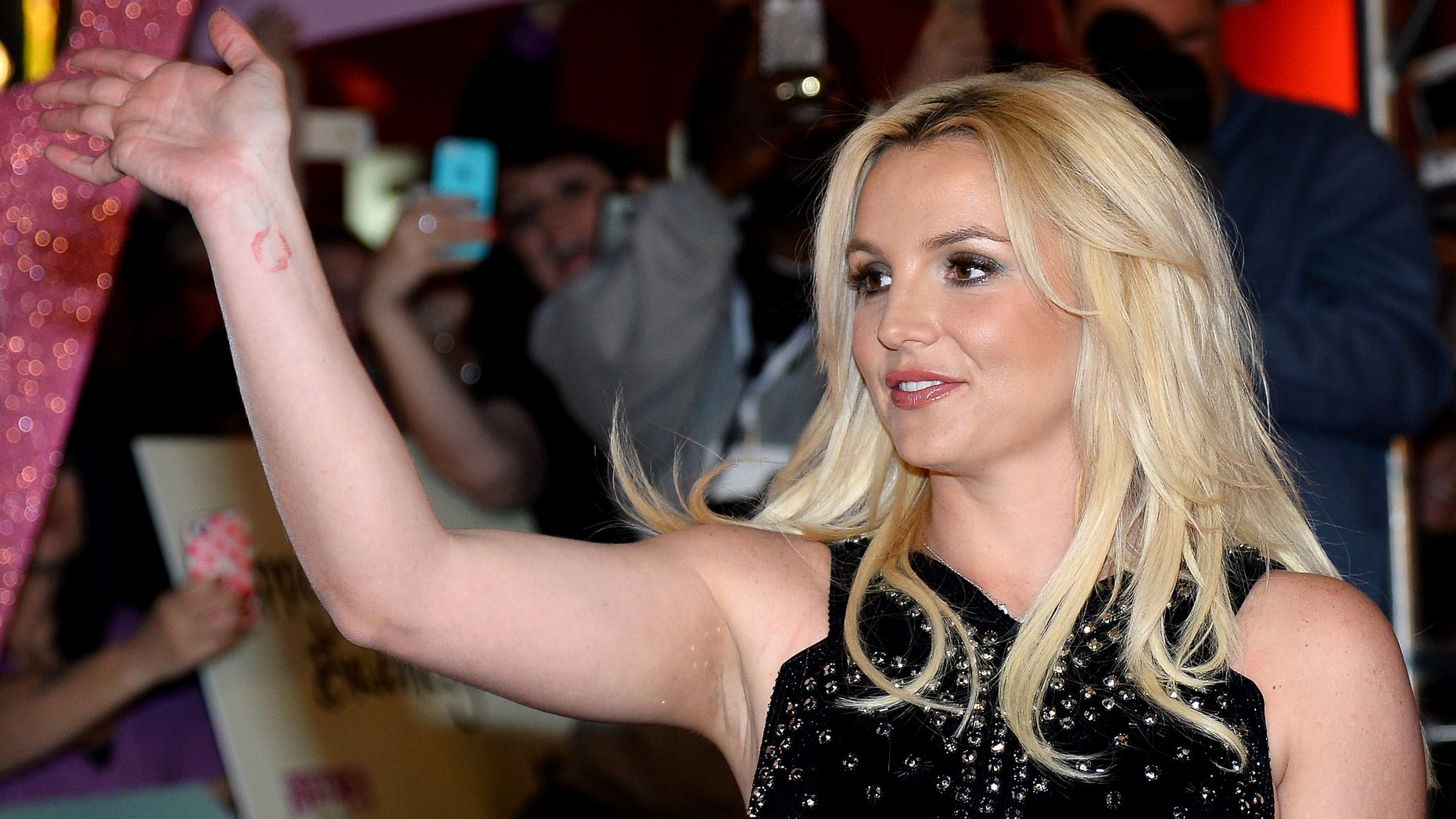 "LAS VEGAS, NV - DECEMBER 03:  Singer Britney Spears waves at a welcome ceremony as she celebrates the release of her new album ""Britney Jean"" and prepares for her two-year residency at Planet Hollywood Resort & Casino on December 3, 2013 in Las Vegas, Nevada. Spears' show ""Britney: Piece of Me"" will debut at the resort on December 27, 2013.  (Photo by Ethan Miller/Getty Images)"