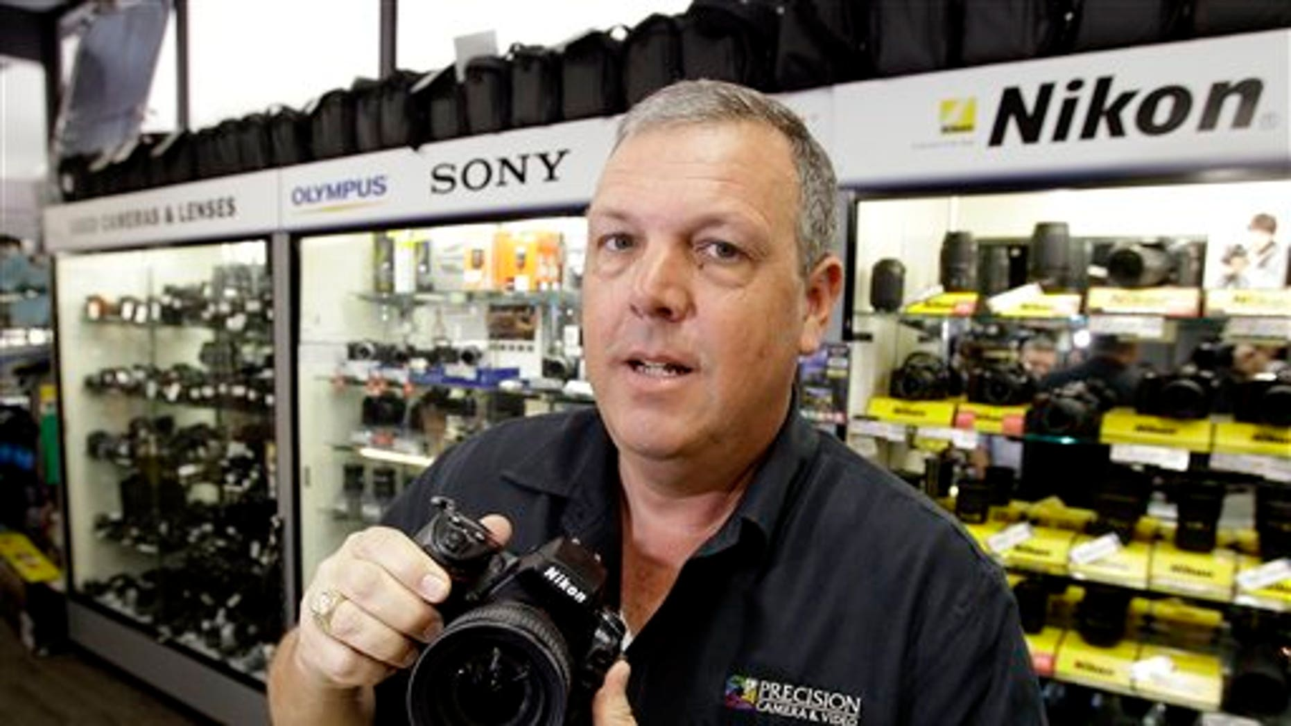 In this April 21, 2011 photo, Gregg Burger, general manager of Precision Camera, an independent retailer, poses for a photo at his store, in Austin, Texas. Burger has lobbied for legislation that would require out-of-state Internet retailers to collect Texas sales tax, creating what he calls a level playing field for local retailers.