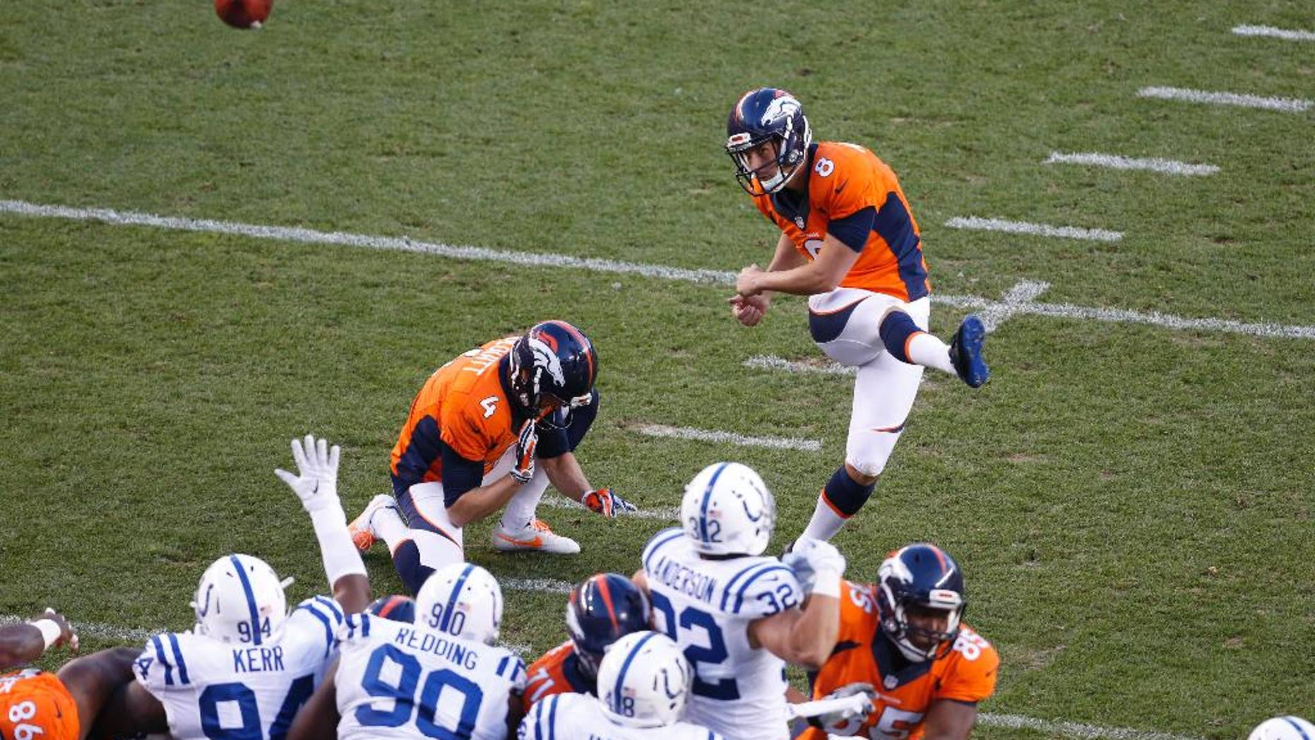 FILE - In this Sept. 7, 2014, file photo, Denver Broncos kicker Brandon McManus (8) kicks against the Indianapolis Colts during the first half of an NFL football game in Denver. McManus is making the most of his NFL tryout while Pro Bowler Matt Prater serves out his four-game suspension kicking field goals at a nearby high school. The Broncos traded a conditional 2015 seventh-round pick to the New York Giants for McManus last month after Prater was suspended for drinking. Prater has been in the NFL's drug program, which includes alcohol, since a DUI arrest in 2011.   (AP Photo/Brennan Linsley, File)