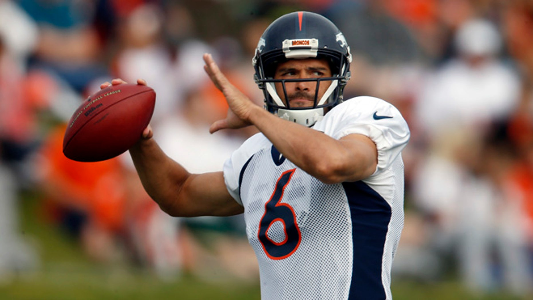 FILE - In this Thursday, Aug. 4, 2016, file photo, Denver Broncos quarterback Mark Sanchez throws a pass during NFL football training camp in Englewood, Colo. The Broncos announced Wednesday, Aug. 10, 2016, that Sanchez will be the starting quarterback for the preseason opener in Chicago on Thursday night. (AP Photo/David Zalubowski, File)