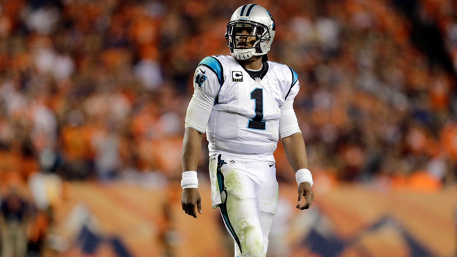 Carolina Panthers quarterback Cam Newton (1) walks to the sidelines during the second half of an NFL football game against the Denver Broncos, Thursday, Sept. 8, 2016, in Denver. (AP Photo/Joe Mahoney)