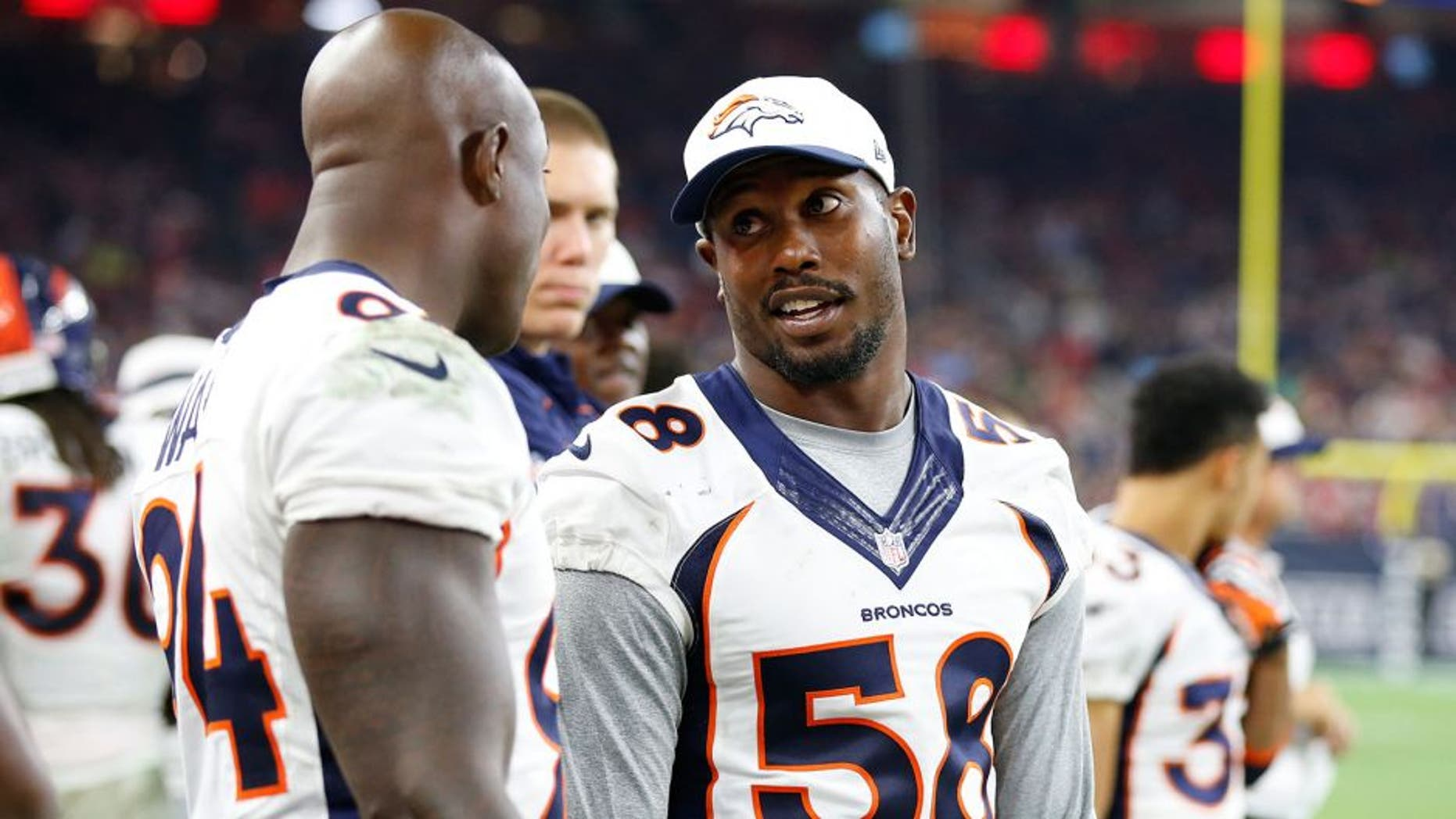 Aug 22, 2015; Houston, TX, USA; Denver Broncos linebacker Von Miller (58) talks with defensive end DeMarcus Ware (94) on the sidelines during the game against the Houston Texans at NRG Stadium. Mandatory Credit: Matthew Emmons-USA TODAY Sports