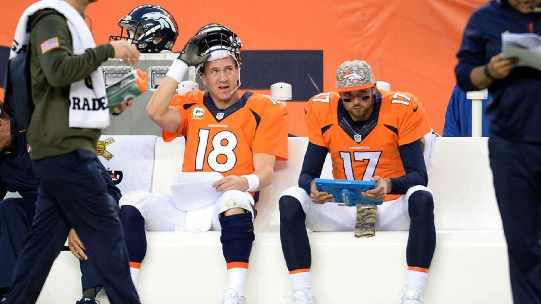 Nov 15, 2015; Denver, CO, USA; Denver Broncos quarterback Peyton Manning (18) sits on the bench along with quarterback Brock Osweiler (17) in the fourth quarter against the Kansas City Chiefs at Sports Authority Field at Mile High. Mandatory Credit: Ron Chenoy-USA TODAY Sports