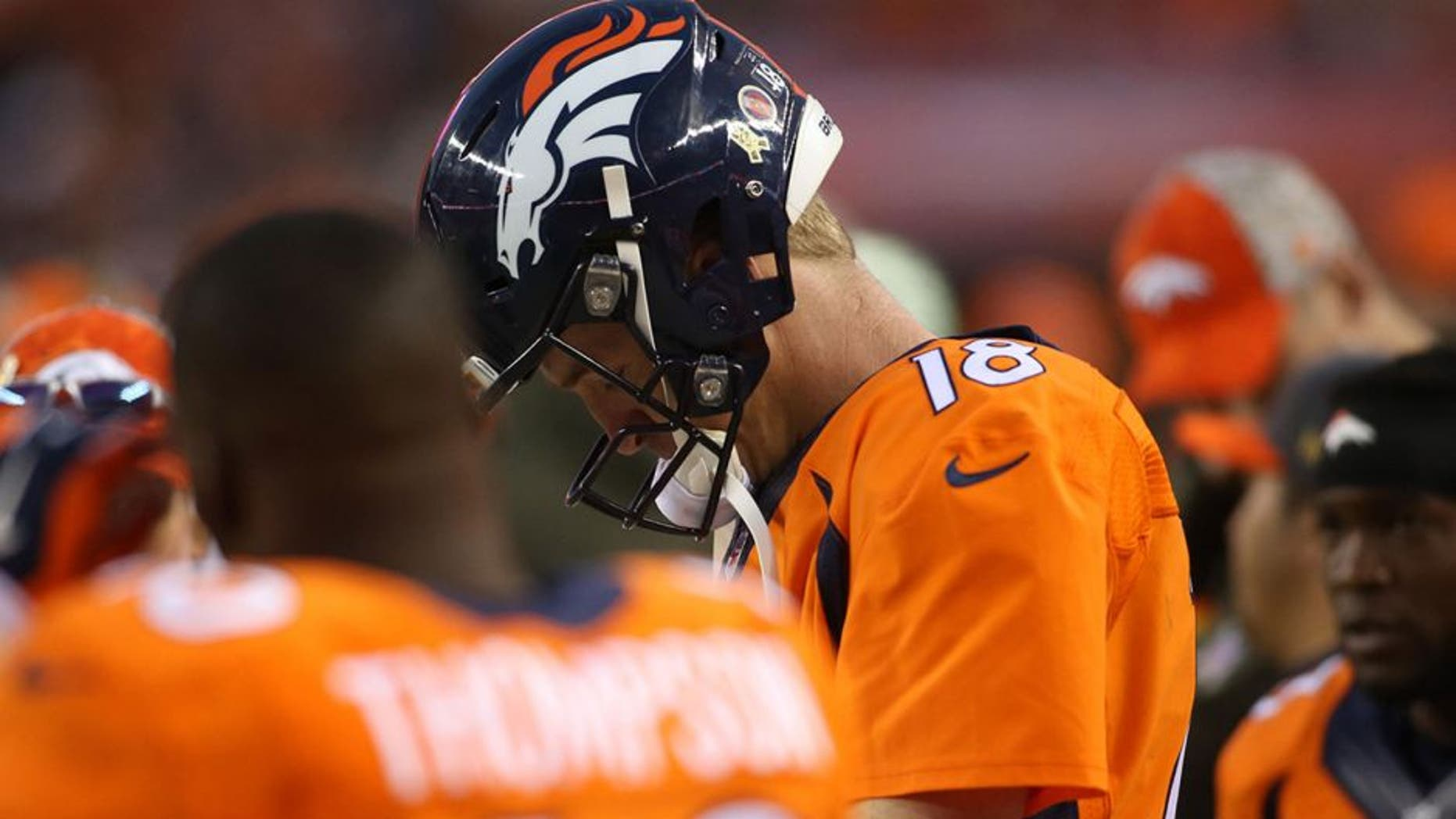 Nov 15, 2015; Denver, CO, USA; Denver Broncos quarterback Peyton Manning (18) reacts on the sidelines during the second half against the Kansas City Chiefs at Sports Authority Field at Mile High. The Chiefs won 29-13. Mandatory Credit: Chris Humphreys-USA TODAY Sports