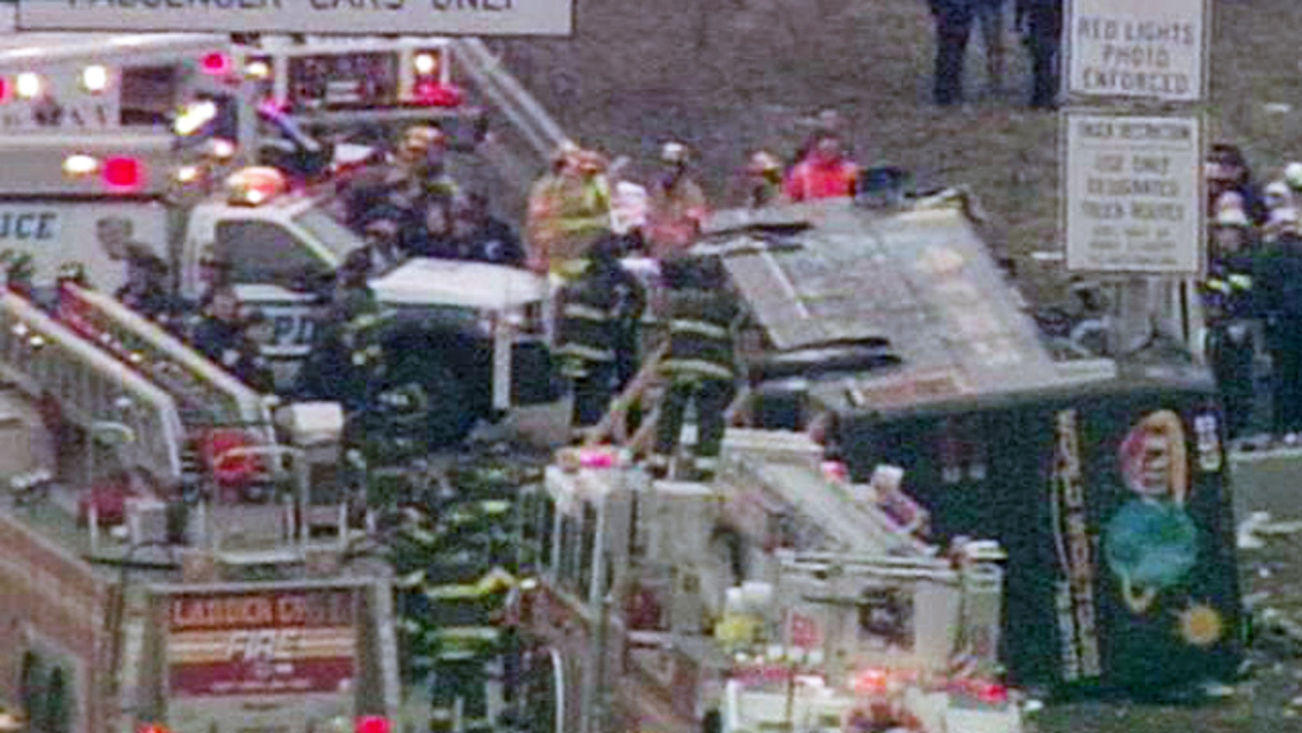 March 12: Fire and rescue officials surround a tour bus that overturned on the New England Thruway in the Bronx, killing at least 13 people.