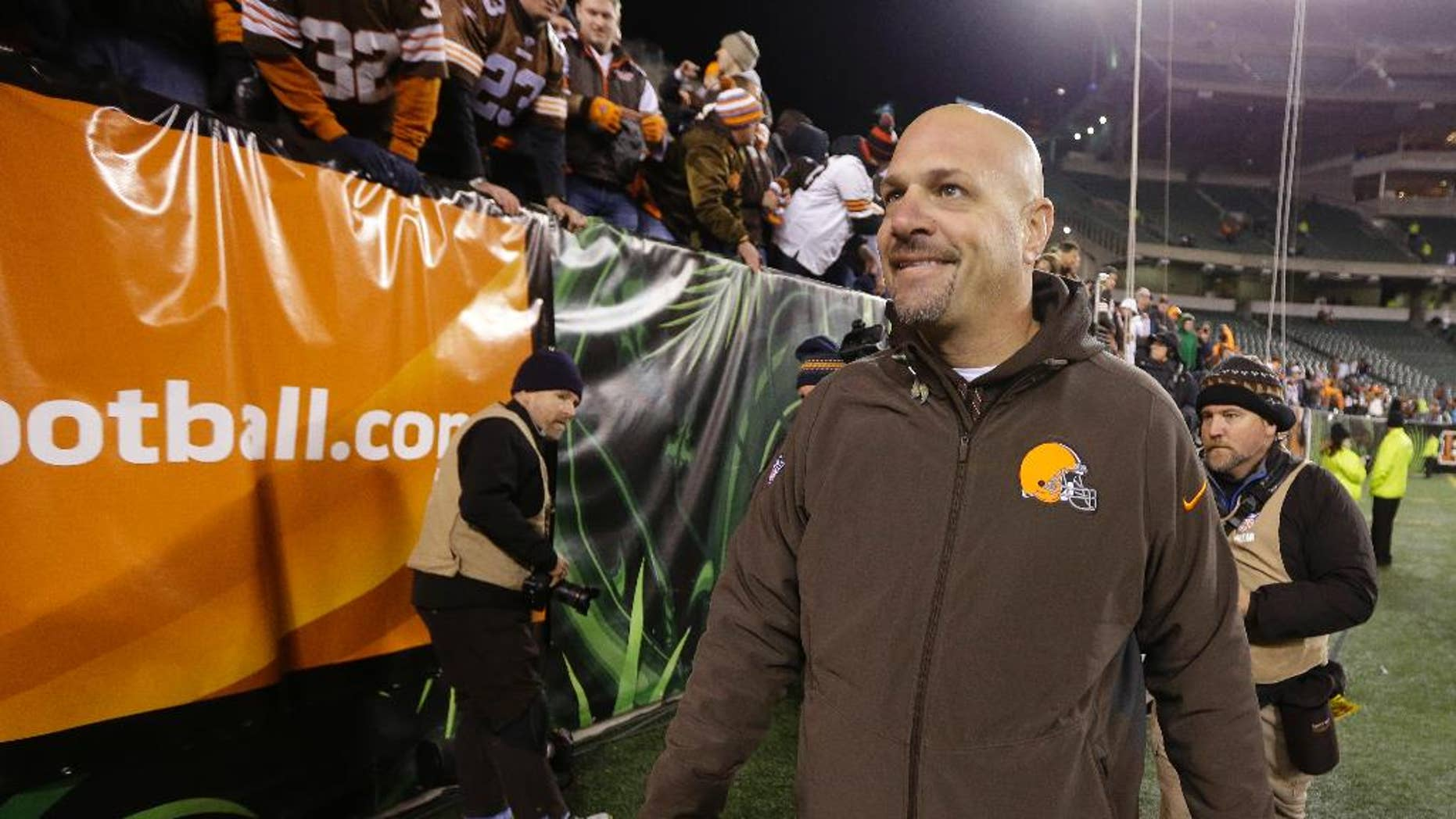 Cleveland Browns coach Mike Pettine smiles as he leave the field following the Browns' 24-3 in an NFL football game against the Cincinnati Bengals on Thursday, Nov. 6, 2014, in Cincinnati. (AP Photo/Michael Conroy)