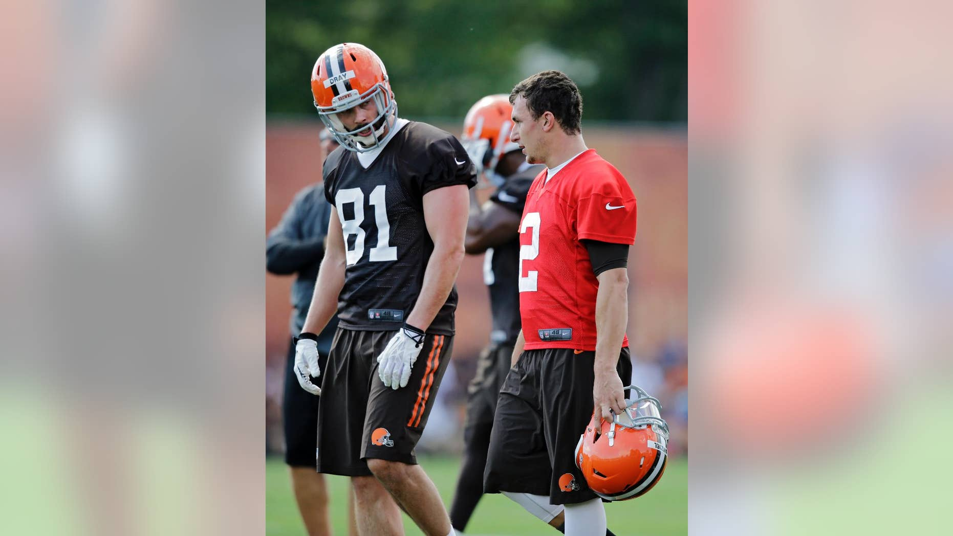Cleveland Browns quarterback Johnny Manziel (2) talks with tight end Jim Dray (81) during the first practice at the NFL football team's training camp in Berea, Ohio Saturday, July 26, 2014. (AP Photo)