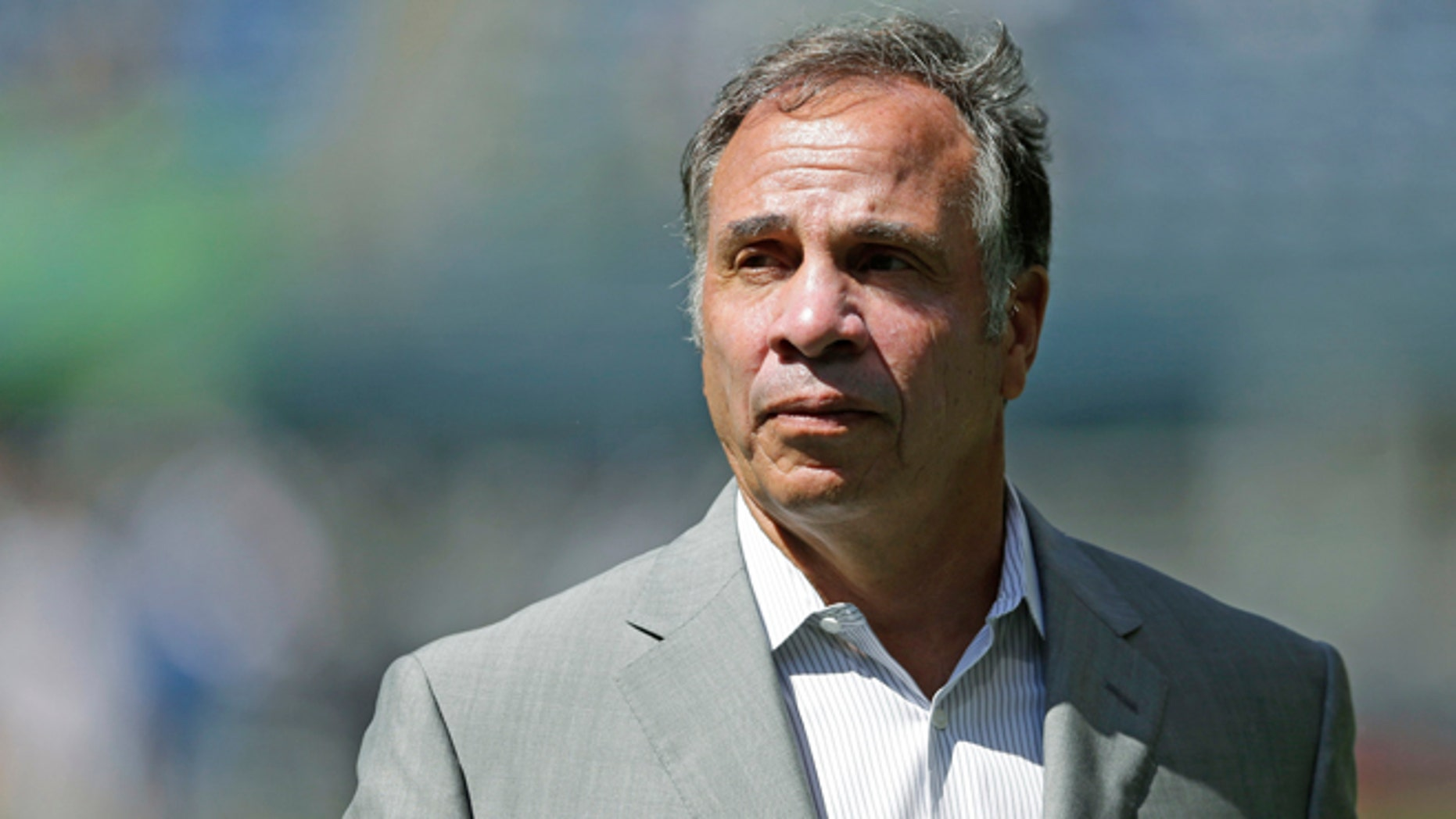 FILE - In this July 31, 2016, file photo, Los Angeles Galaxy Bruce Arena walks on the pitch following an MLS soccer match against the Seattle Sounders, in Seattle. Jurgen Klinsmann was fired as coach of the U.S. soccer team on Monday, Nov. 21, 2016, six days after a 4-0 loss at Costa Rica dropped the Americans to 0-2 in the final round of World Cup qualifying. LA Galaxy coach Bruce Arena is the favorite to succeed Klinsmann. (AP Photo/Ted S. Warren, File)