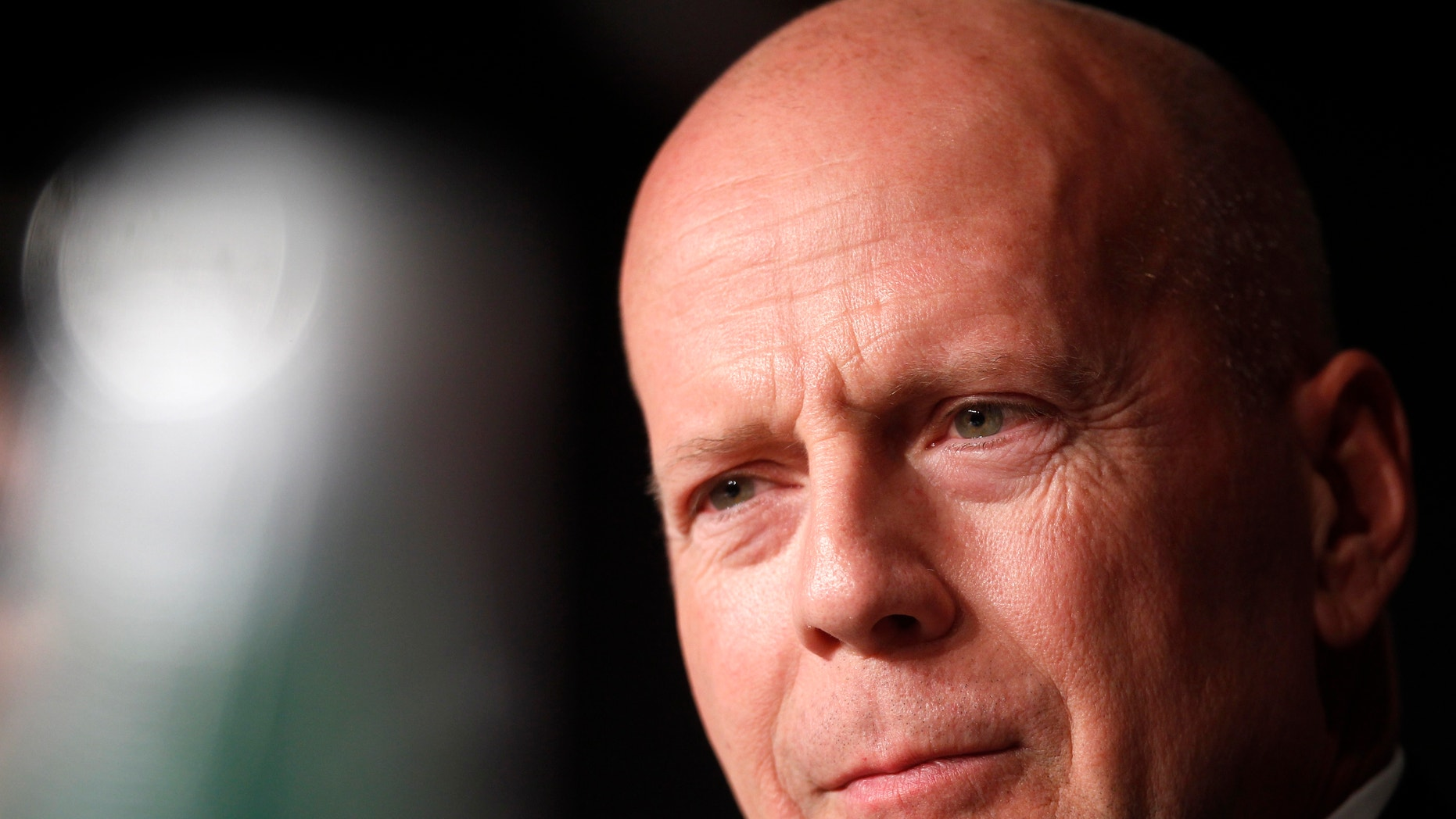 """Bruce Willis attends a news conference for the film """"Moonrise Kingdom"""" on May 16, 2012."""