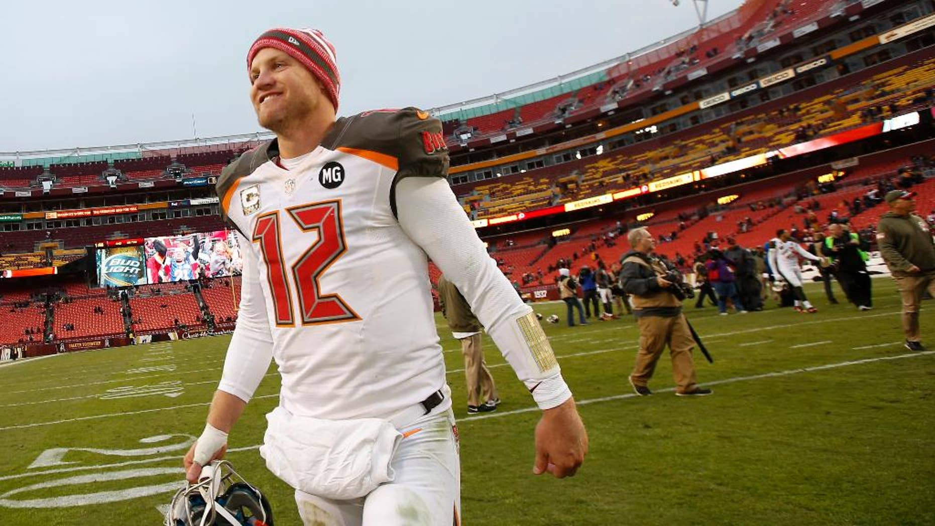 Tampa Bay Buccaneers quarterback Josh McCown (12) smiles as he walks off the field after a 27-7 victory over the Washington Redskins in an NFL football game in Landover, Md., Sunday, Nov. 16, 2014. (AP Photo/Alex Brandon)