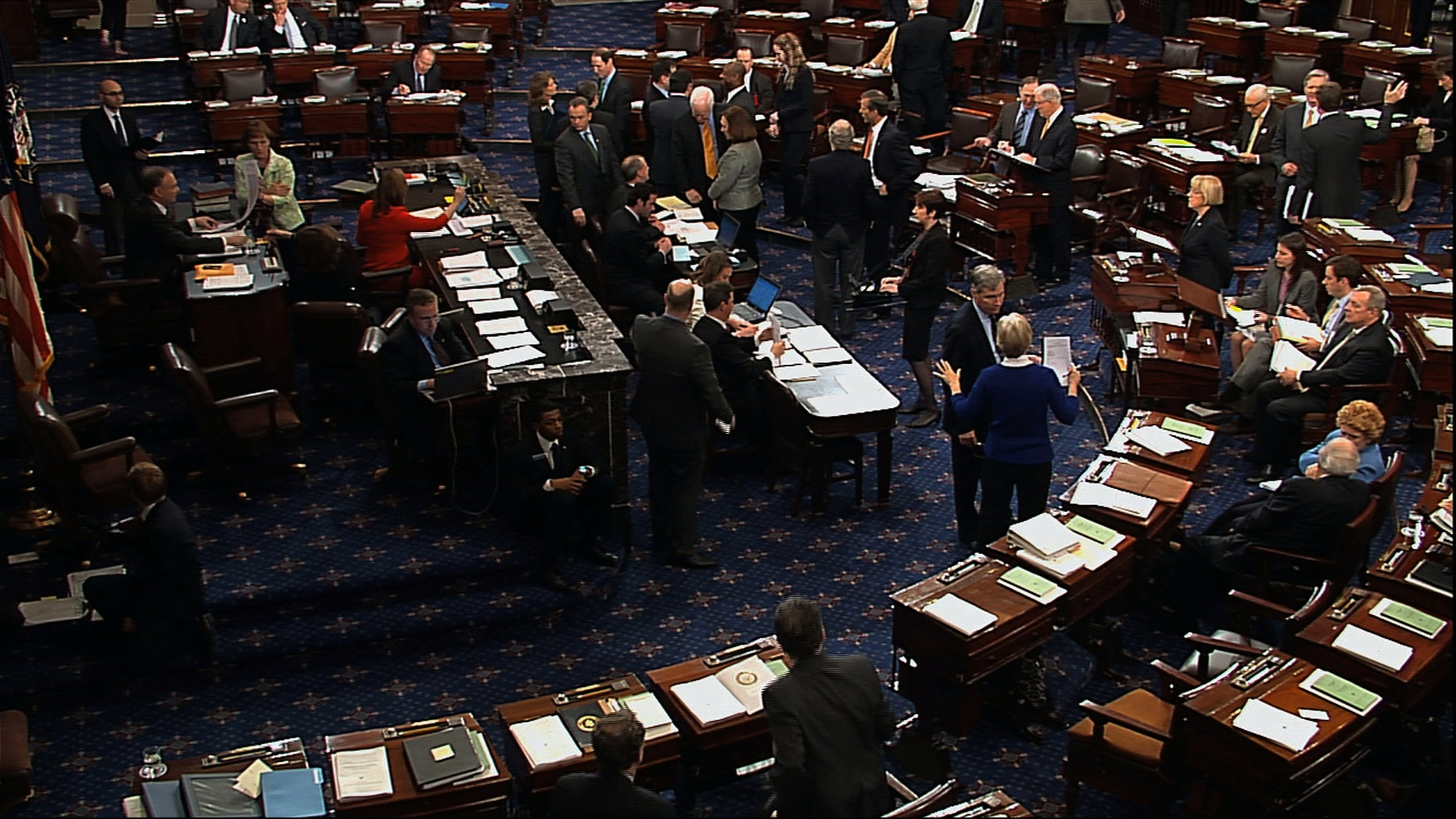 In this video image from Senate Television, senators speak on the floor of the U.S. Senate during voting on an amendment to the budget resolution at the Capitol on Washington, Friday, March 22, 2013. (AP Photo/Senate Television)