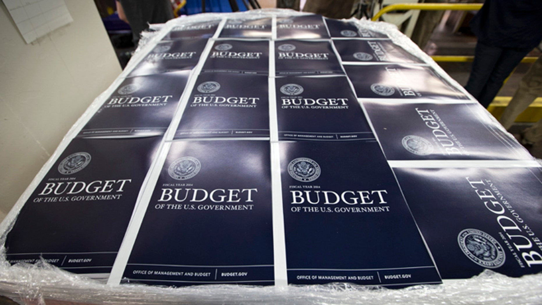 Copies of President Obama's proposed federal budget plan for fiscal year 2014 are prepared for delivery at the U.S. Government Printing Office.