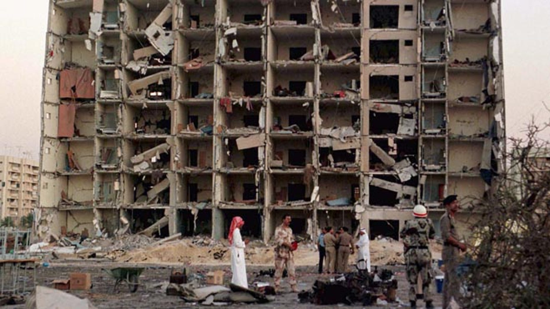 JUNE 1996: U.S. and Saudi investigators work into the night searching for clues outside the apartment building destroyed by a bomb at the Khobar Towers housing complex for U.S. military personnel in Dhahran.