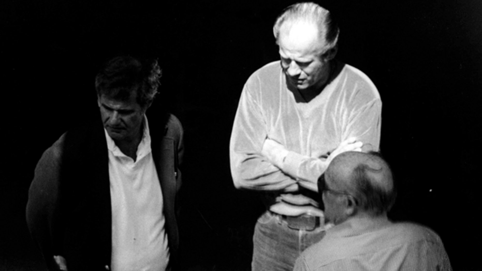 "This 1980 black and white surveillance photo released by the U.S. Attorney's Office and presented as evidence during the first day of a trial for James ""Whitey"" Bulger in U.S. District Court in Boston, shows Bulger, center, with Ted Berenson, left, and Phil Wagenheim at a Lancaster Street garage in Boston's North End."