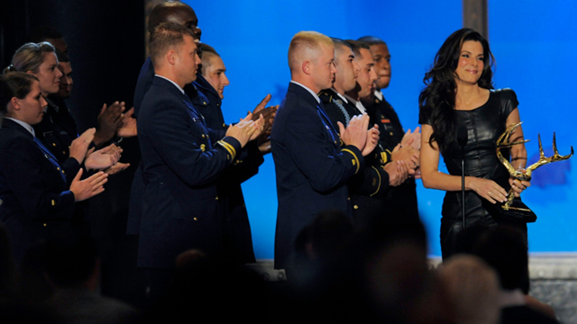"""June 5: Sandra Bullock accepts the Troops Choice Award onstage at Spike TV """"Guy's Choice"""" awards in Culver City, Calif."""
