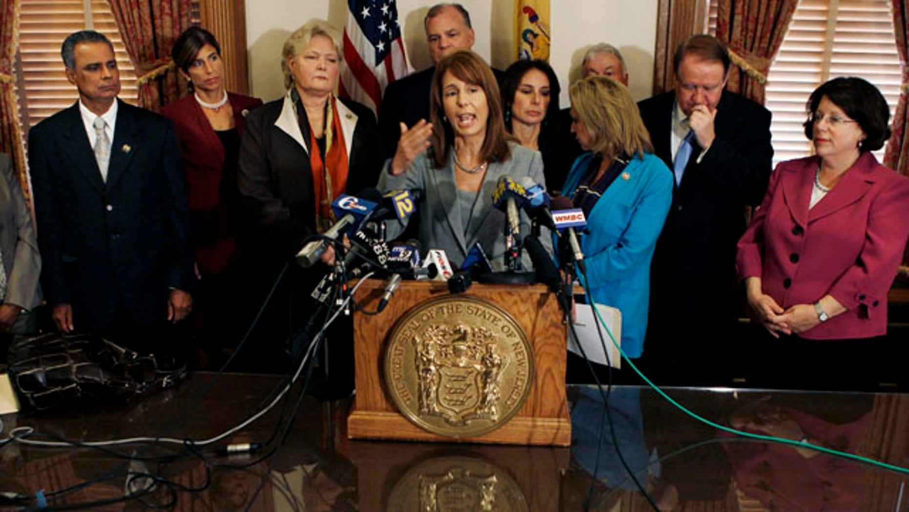 Oct. 25, 2010: New Jersey Sen. Barbara Buono, D-Edison, stands with other lawmakers in Trenton, N.J. as she answers a question about a bill they introduced to toughen the state's anti-bullying laws after the widely publicized suicide of Rutgers University student Tyler Clementi.