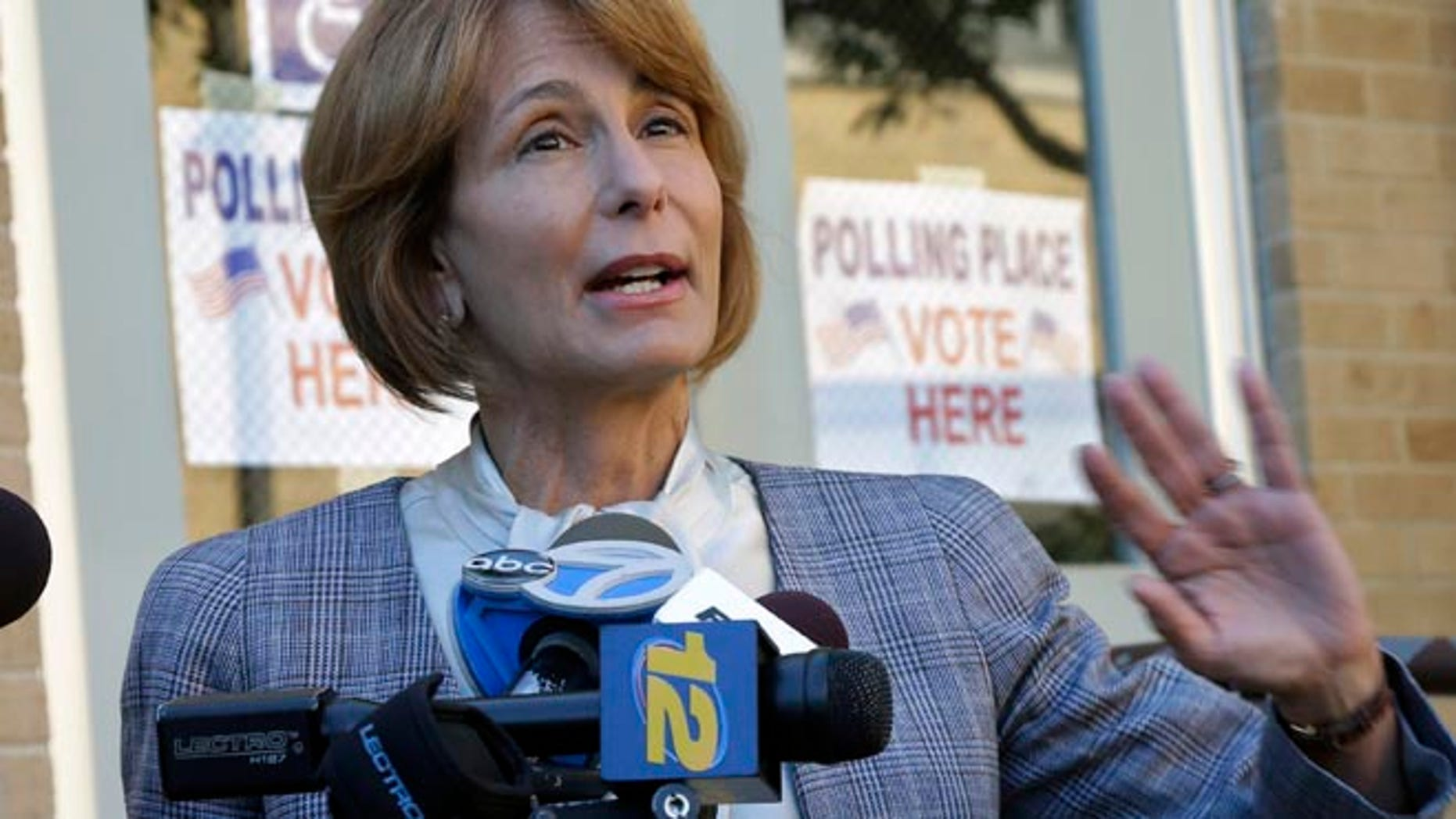June 4, 2013: Democratic candidate for New Jersey governor, state Sen. Barbara Buono, answers a question after casting her primary election vote in Metuchen, N.J.