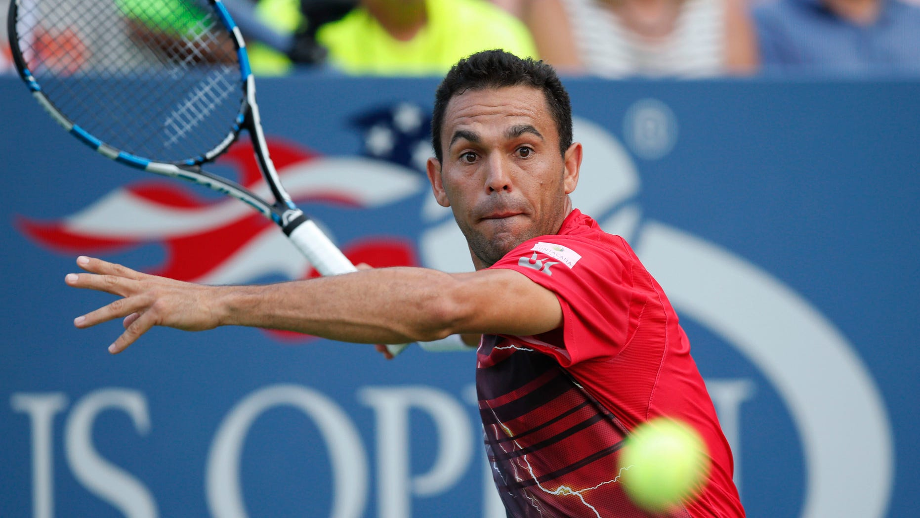 Victor Estrella Burgos, of the Dominican Republic, returns the ball during his first-round match against Jack Sock, of the United States, at the U.S. Open tennis tournament in New York, Tuesday, Sept. 1, 2015. (AP Photo/Kathy Willens)