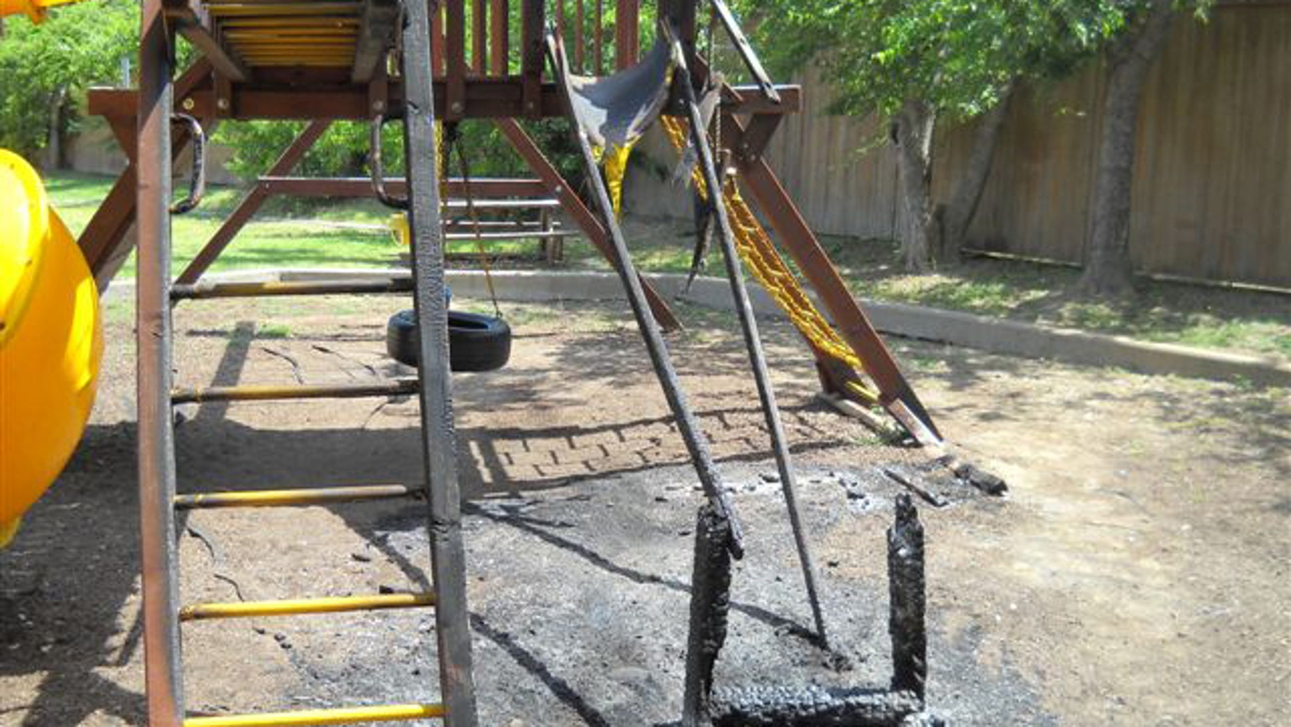 Remains of Dar El-Eman Islamic Center's playground after it was torched on July 25.