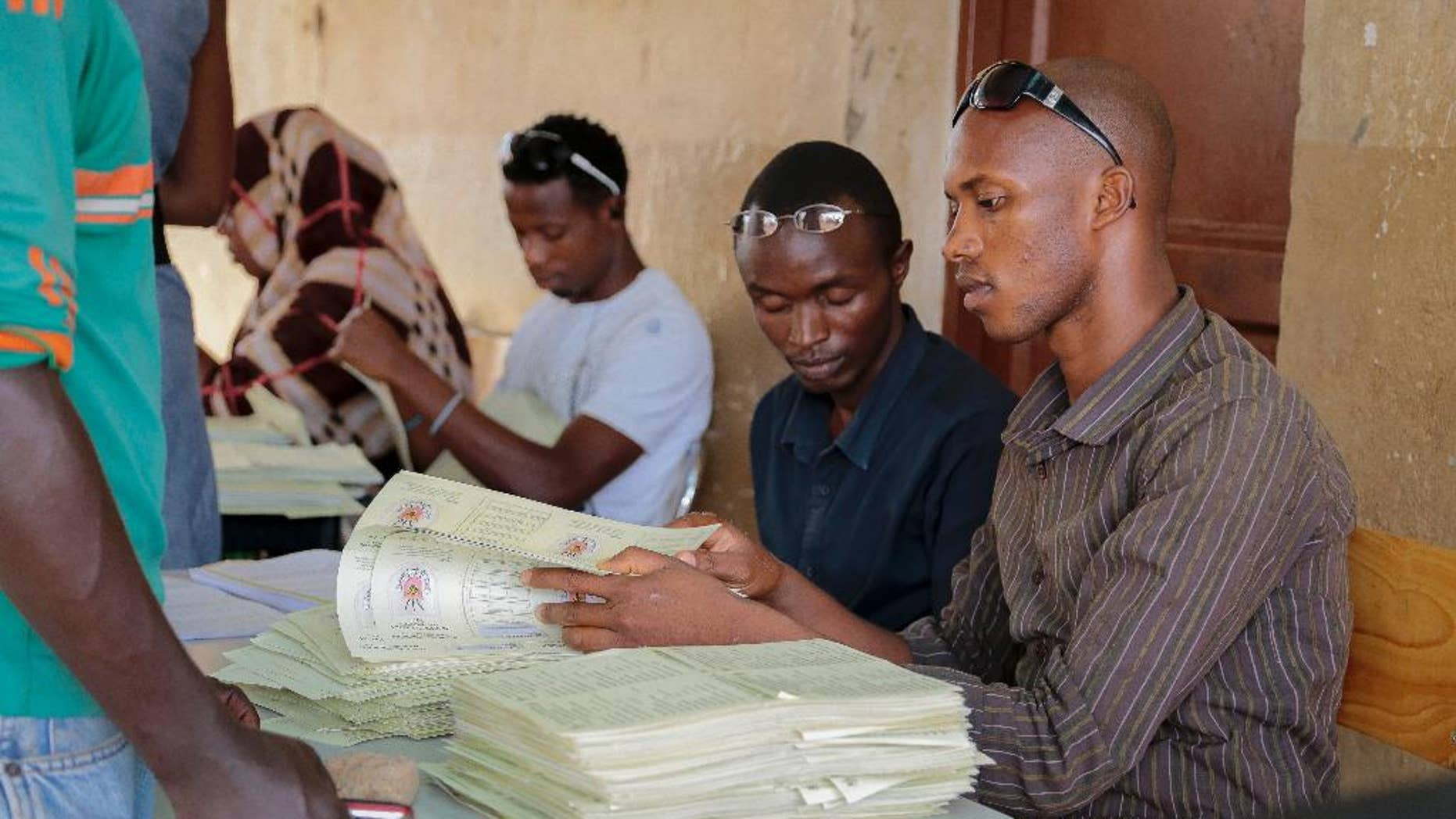FILE - In this Thursday, June 4, 2015 file photo, electoral voter cards are distributed in the capital Bujumbura, Burundi. A spokesman for Burundi's electoral commission told The Associated Press Monday, June 8, 2015 that a new electoral schedule had been sent to President Pierre Nkurunziza for his approval, with presidential elections proposed to be held on July 15. (AP Photo/Berthier Mugiraneza, File)