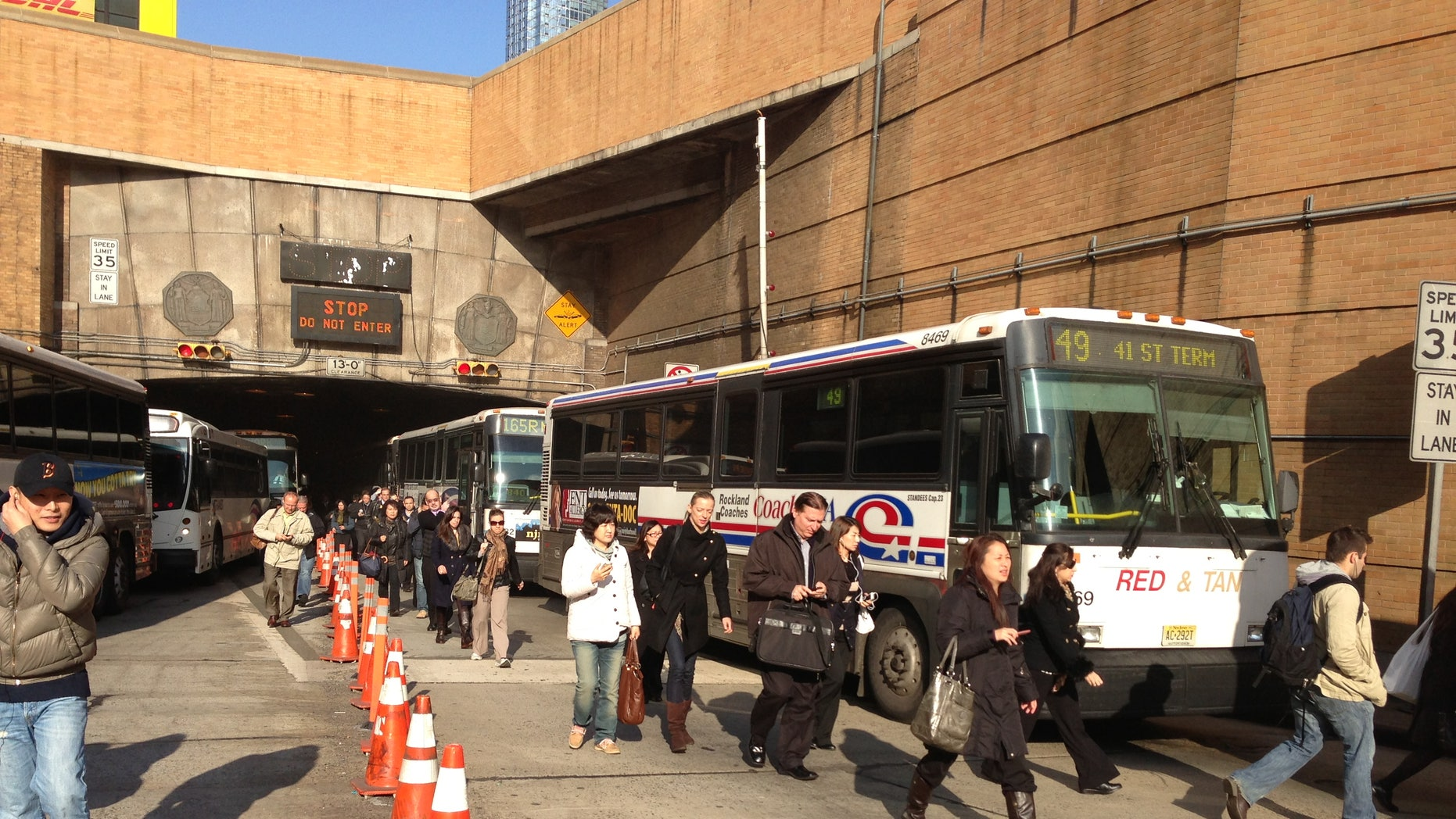 Nov. 12, 2012: Morning commuters exit the Lincoln Tunnel in New York after the tunnel was closed after two buses collided near the tunnel in New Jersey, injuring about 20 people.