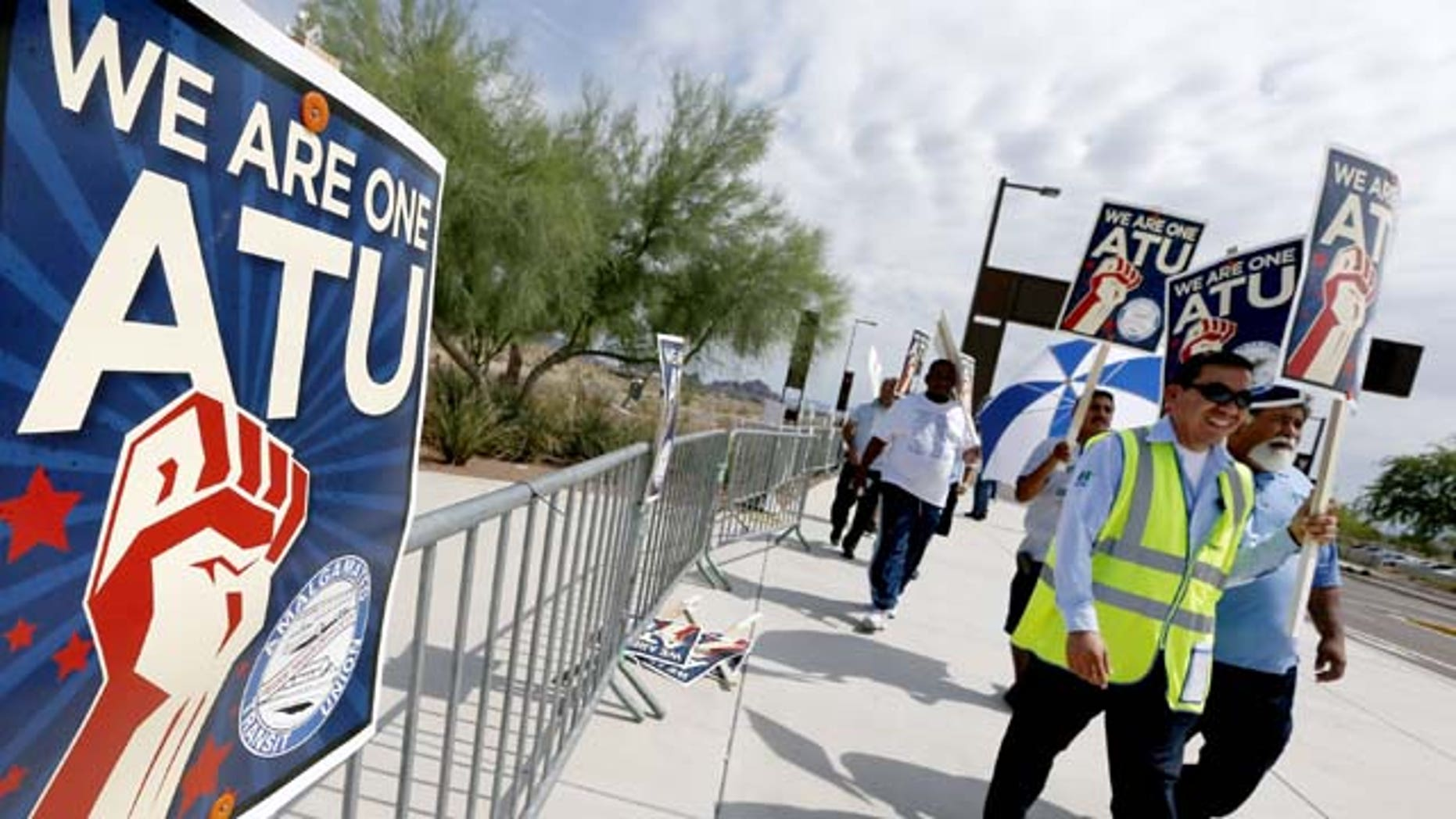 August 1, 2013: Members of the Amalgamated Transit Union Local 1433 strike in front of the First Transit Inc., bus depot in Tempe, Ariz,