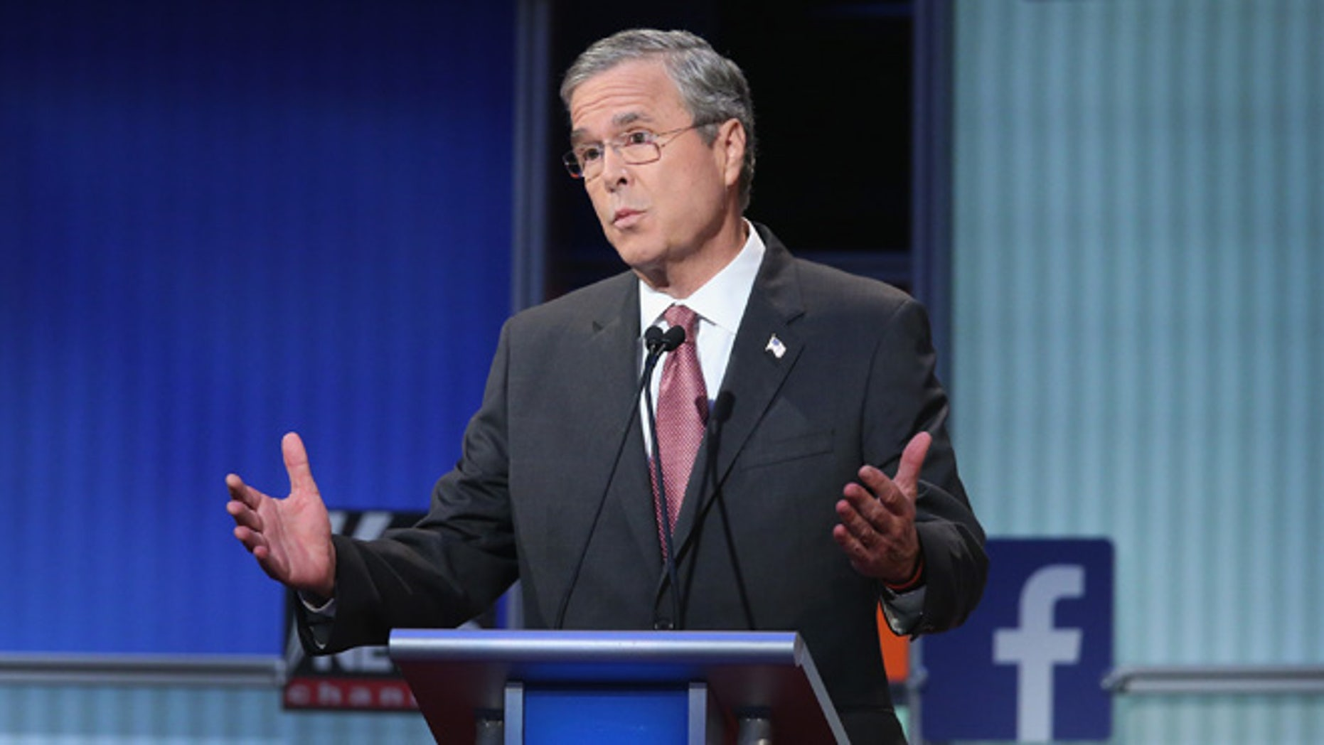 CLEVELAND, OH - AUGUST 06:  Republican presidential candidate Jeb Bush fields a question during the first Republican presidential debate hosted by Fox News and Facebook at the Quicken Loans Arena on August 6, 2015 in Cleveland, Ohio. The top ten GOP candidates were selected to participate in the debate based on their rank in an average of the five most recent political polls.  (Photo by Scott Olson/Getty Images)