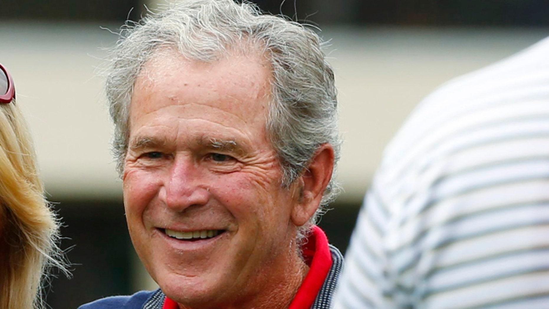 October 3, 2013: Former U.S. President George W. Bush at Muirfield Village Golf Club in Dublin, Ohio.