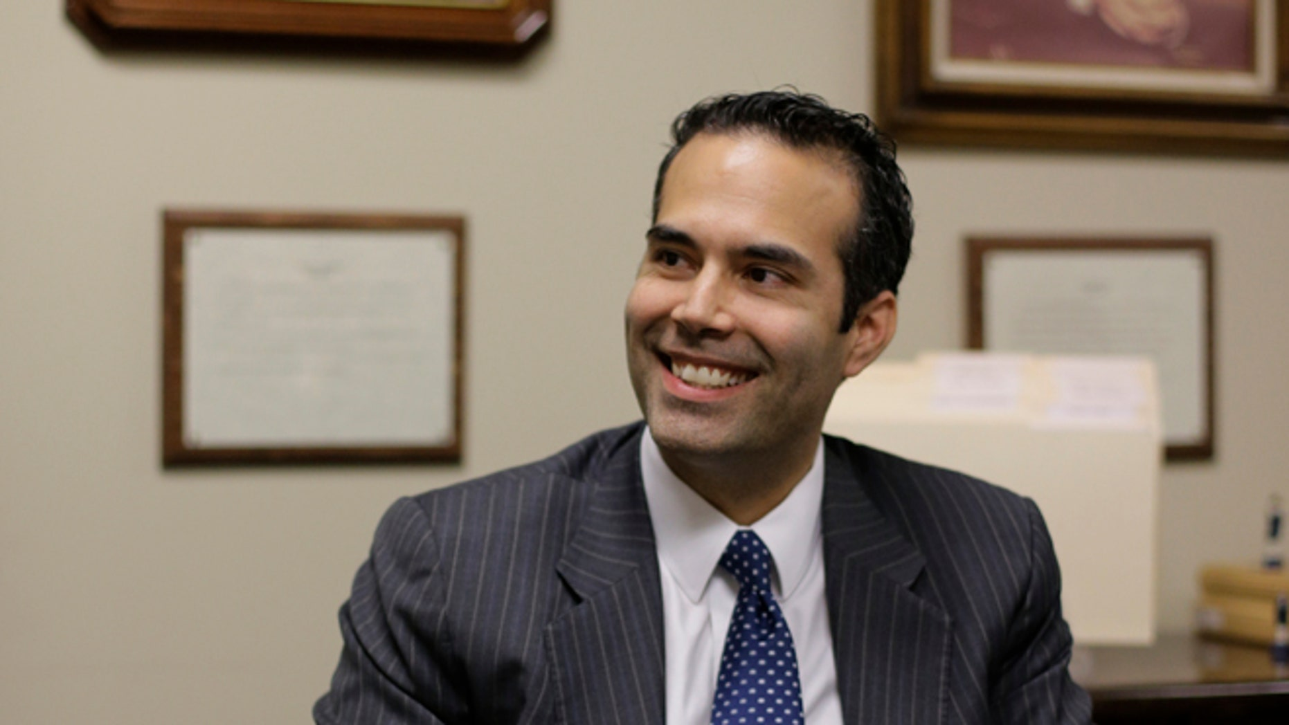 FILE: Nov. 19, 2013: George P. Bush visits the Republican Party of Texas headquarters where he formally filed to run for Texas land commissioner, in Austin, Texas.