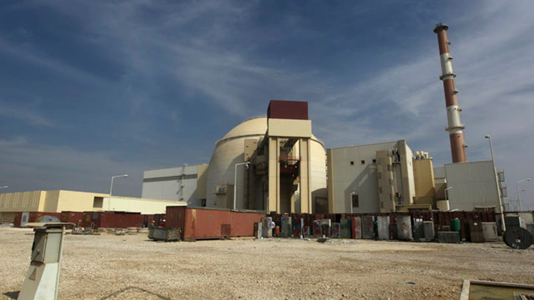 Oct. 26, 2010: A worker rides a bicycle in front of the reactor building of the Bushehr nuclear power plant in Iran.