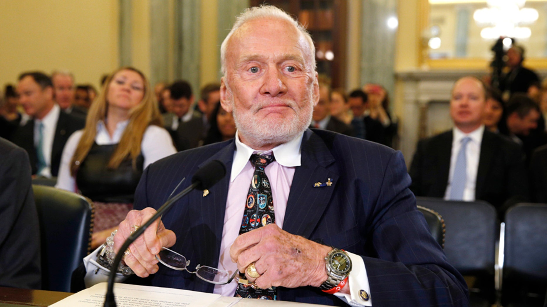Former astronaut Buzz Aldrin takes his seat to testify before a Senate hearing on Capitol Hill in Washington, February 24, 2015.