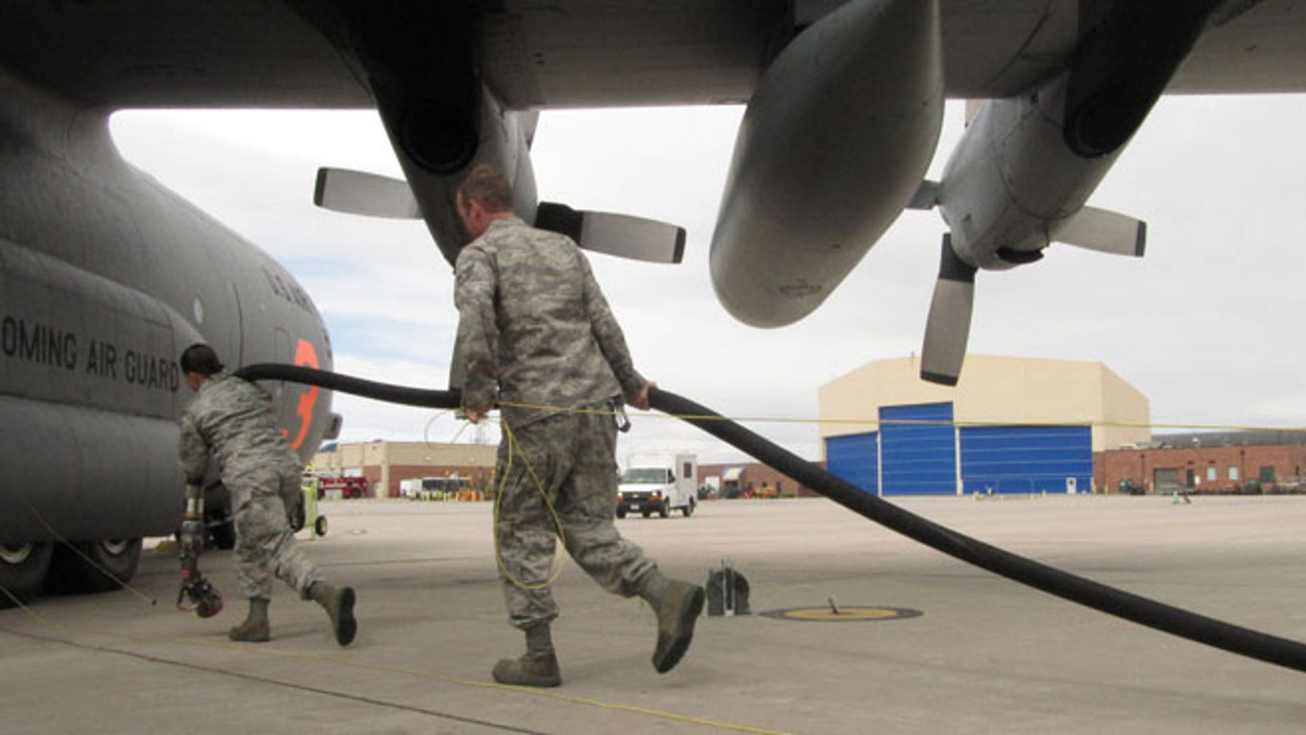 In this Wednesday April 18,2012 file photo Wyoming Air National Guard members are shown training in Cheyenne, Wyo., on using C-130 transport planes to drop fire retardant at wildfires.