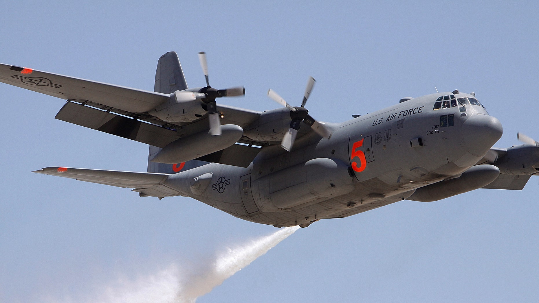 FILE 2009: Colorado Reserve C-130 drops water on a target during a certification flight at the Tucson International Airport.