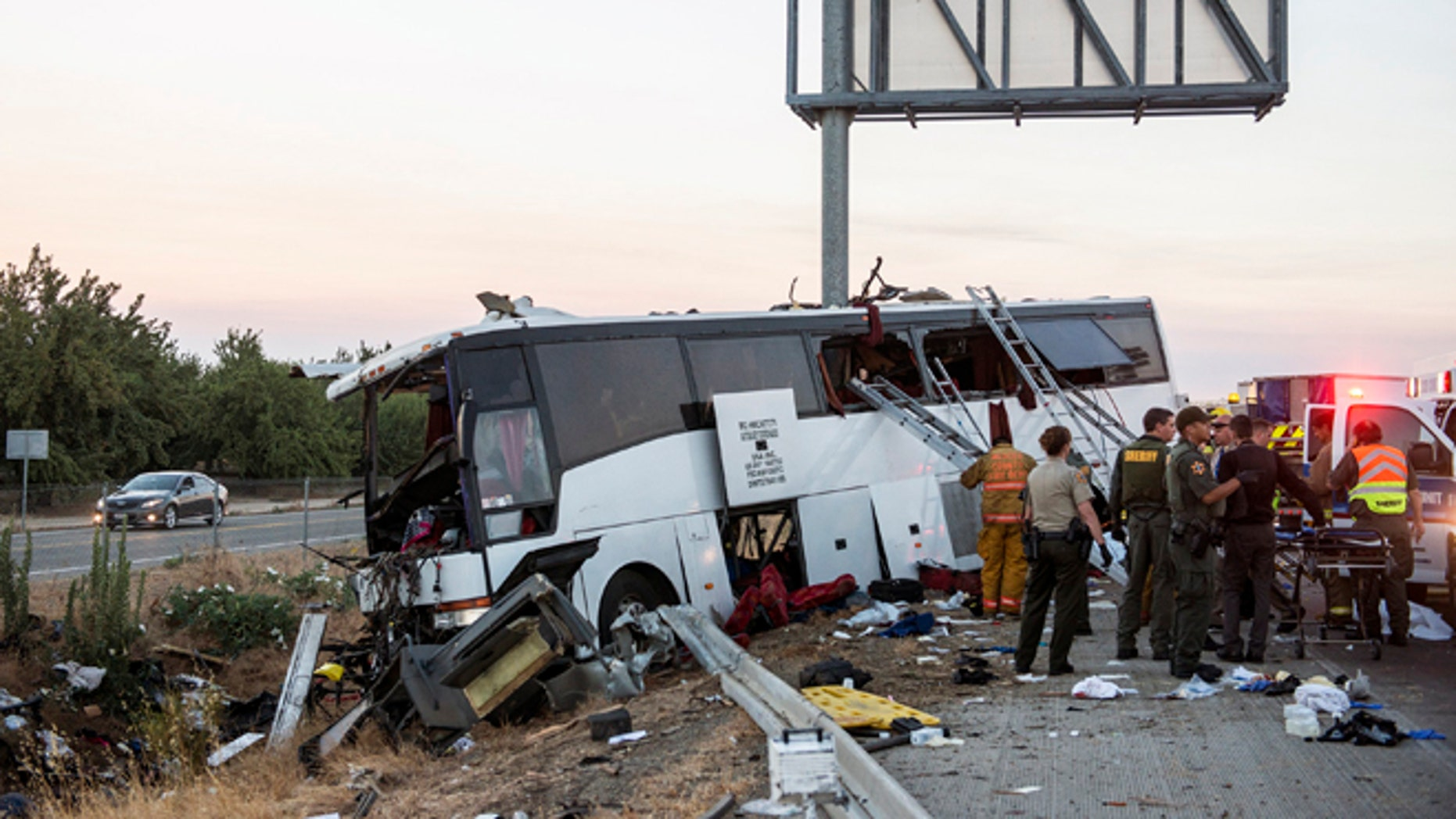 Rescue crews work at the scene of a charter bus crash in Calif., Tuesday, Aug. 2, 2016.