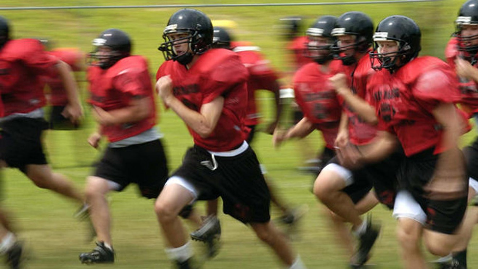 Madison High School football players run sprints during a half pad practice on Friday, Aug. 11, 2006, in Vienna, Va.  It's that time of year: Kids hit the ball fields running, and often hobble or are carried off. Back to school means back to organized sports for more than 30 million children and teenagers, and roughly 2.6 million emergency-room visits during the year for resulting injuries. Basketball, football and soccer lead the list of injury-prone team sports. (AP Photo/Kevin Wolf)